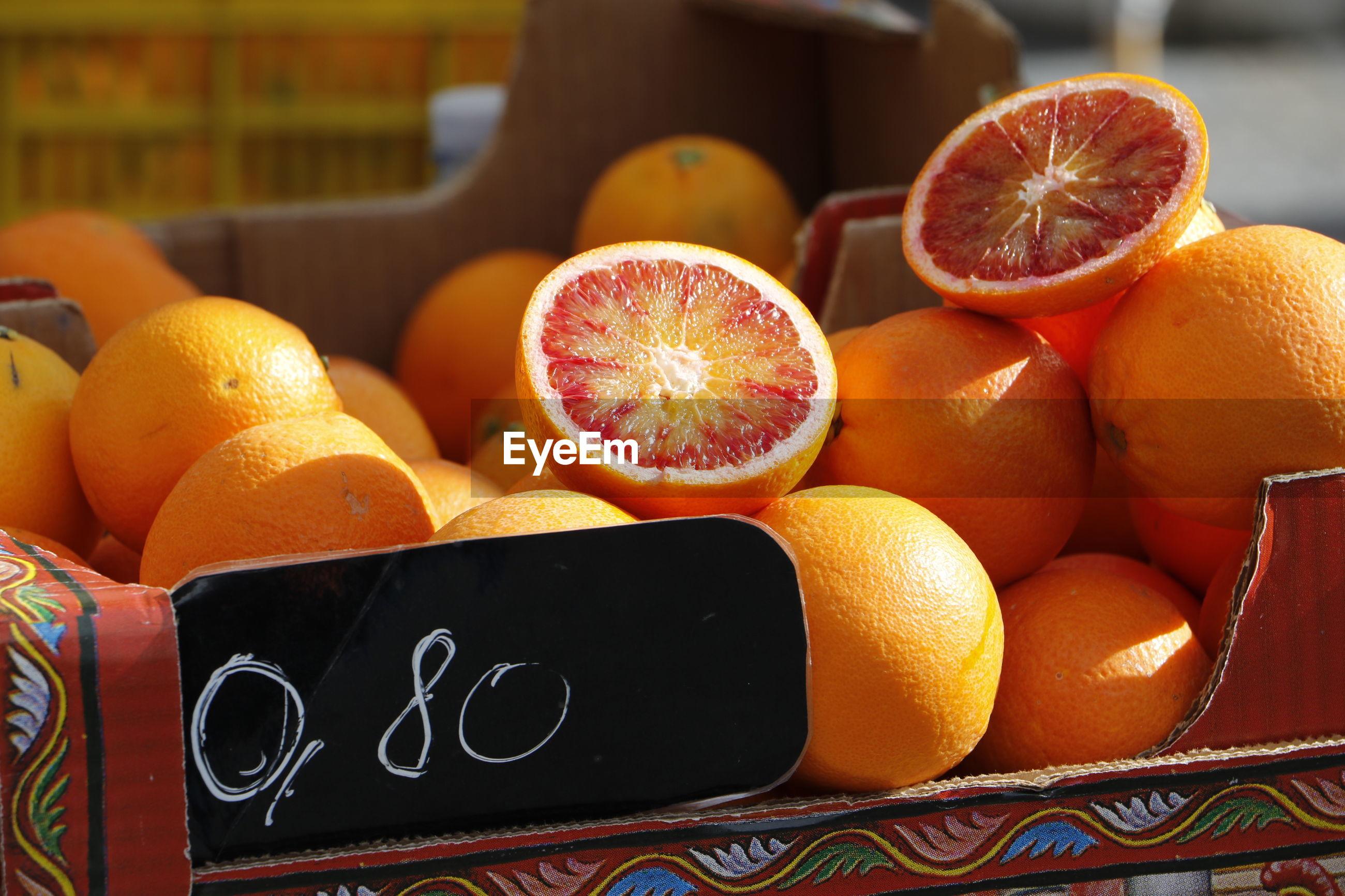 Close-up of grapefruits at market stall