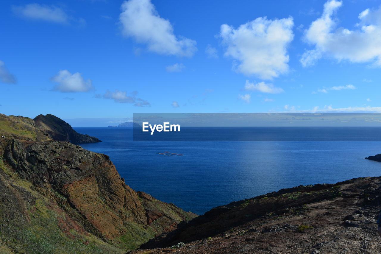 sky, cloud - sky, sea, water, scenics - nature, beauty in nature, tranquil scene, tranquility, horizon, horizon over water, blue, nature, land, idyllic, non-urban scene, mountain, day, beach, no people, outdoors, rocky coastline