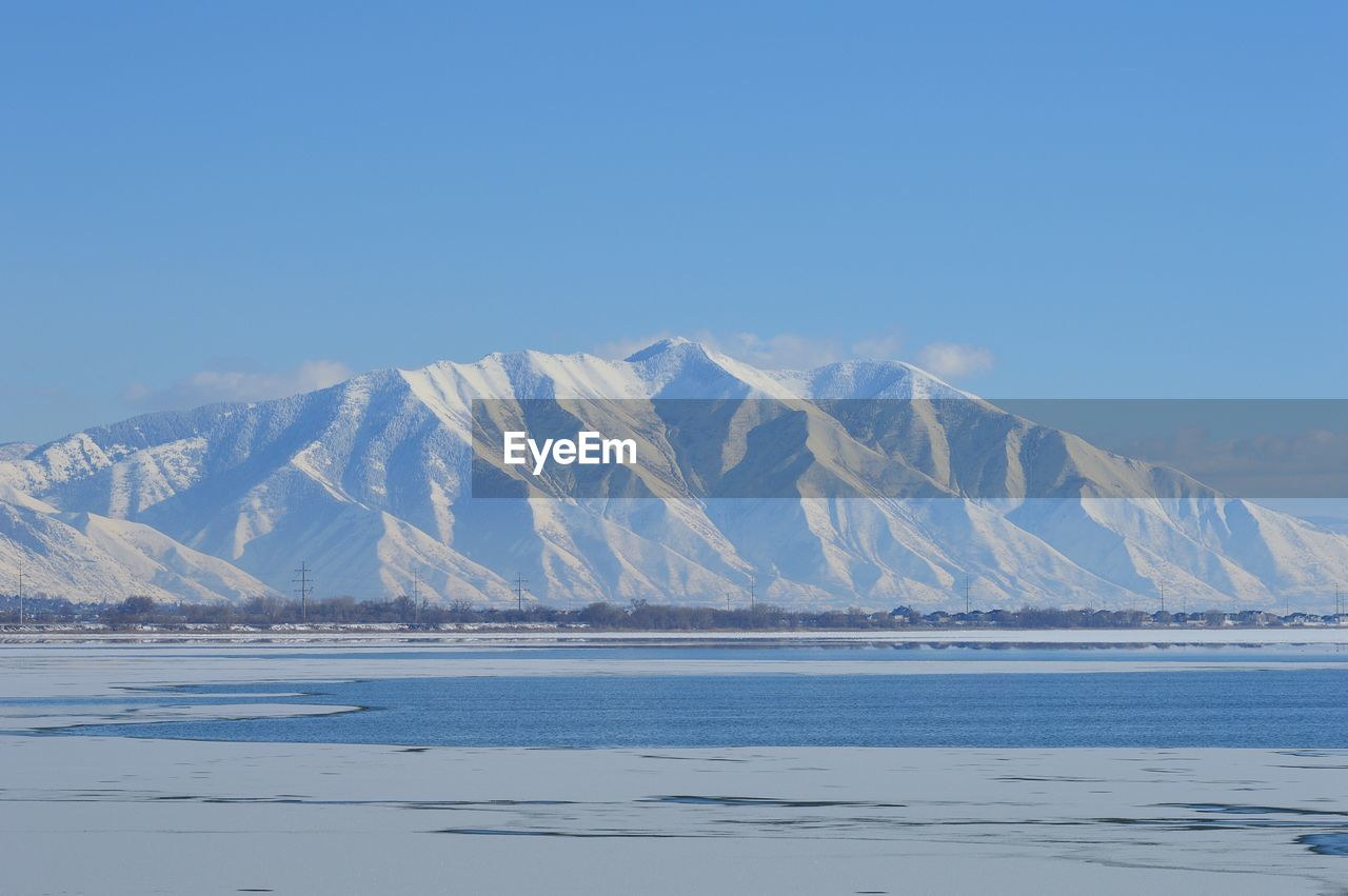 cold temperature, tranquil scene, nature, beauty in nature, scenics, tranquility, snow, mountain, winter, waterfront, no people, outdoors, frozen, blue, ice, water, day, lake, salt flat, landscape, mountain range, salt - mineral, clear sky, sky, iceberg