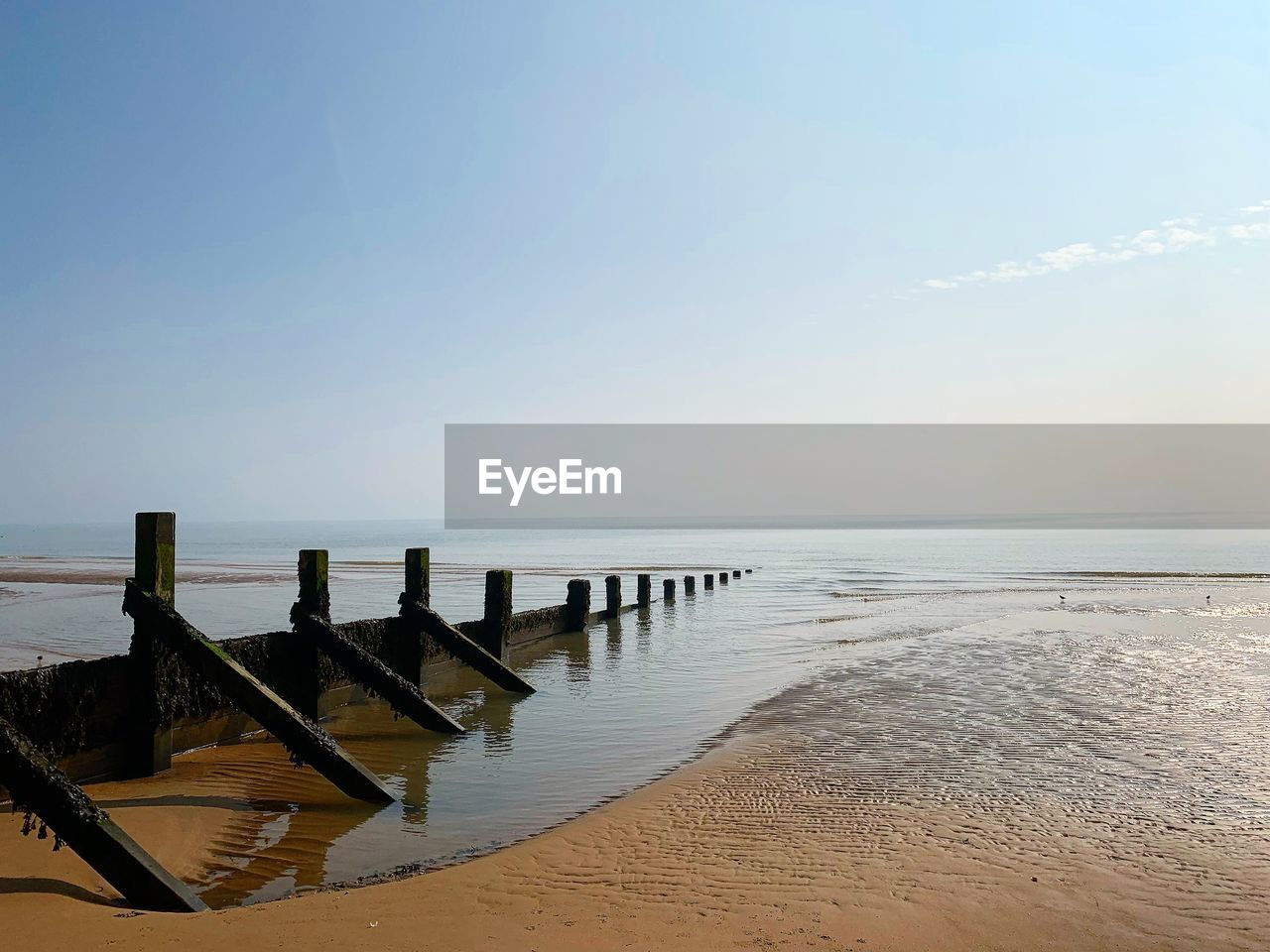 water, sky, beauty in nature, scenics - nature, sea, beach, tranquil scene, wood - material, horizon, tranquility, wooden post, horizon over water, nature, land, post, day, sand, no people, pier, outdoors, groyne