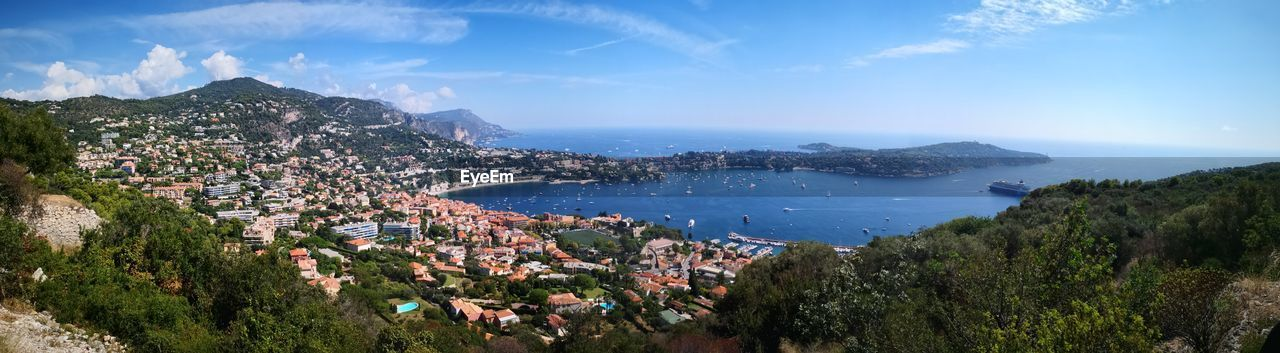 water, architecture, building exterior, built structure, sky, city, high angle view, nature, sea, building, scenics - nature, panoramic, day, residential district, mountain, plant, tree, cloud - sky, beauty in nature, cityscape, outdoors, no people, townscape, bay