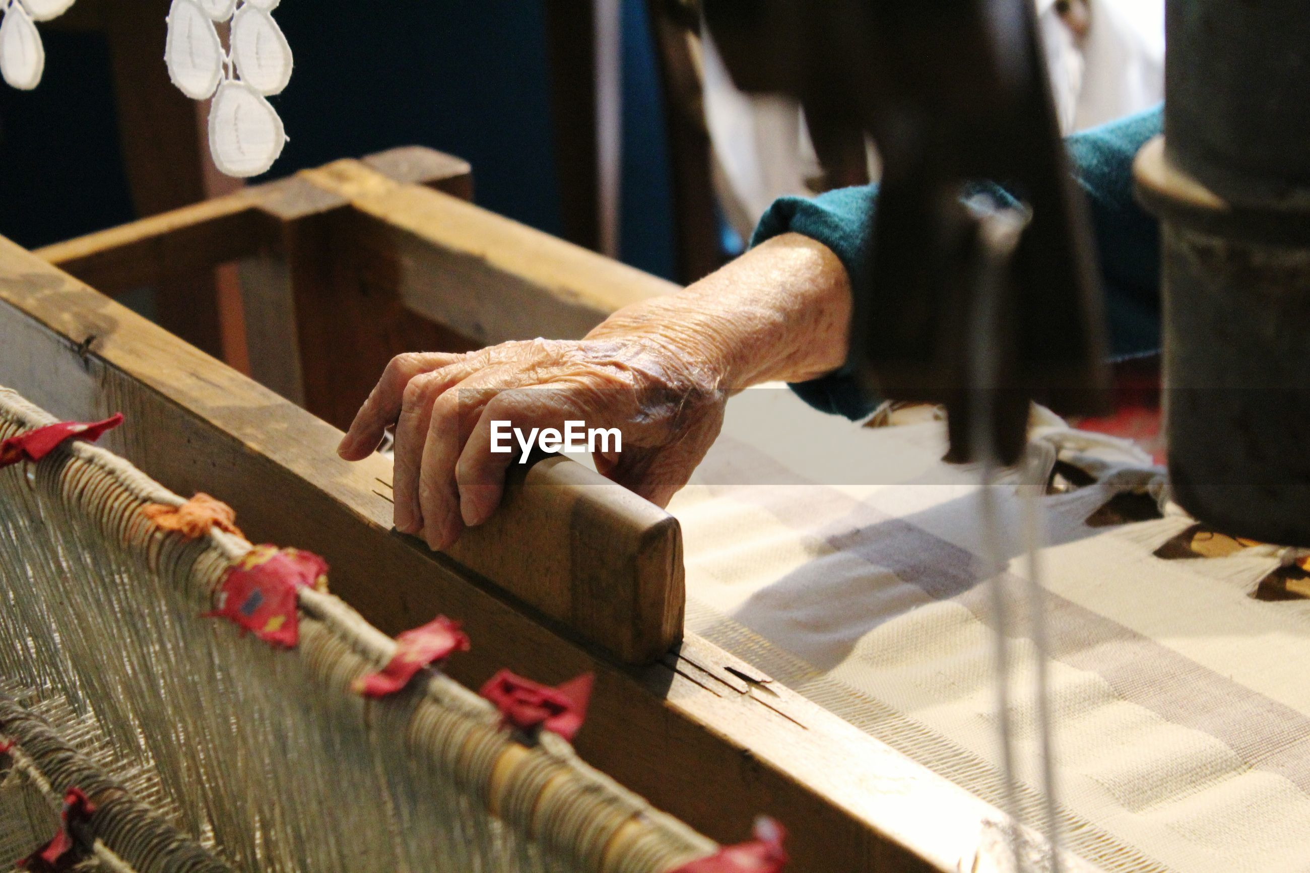 Close-up of old fashioned fabric loom