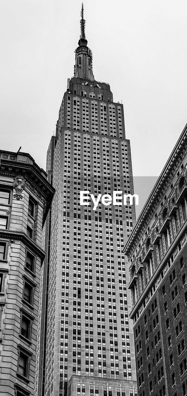 building exterior, architecture, built structure, building, low angle view, sky, office building exterior, city, tall - high, skyscraper, no people, tower, office, modern, day, nature, travel destinations, clear sky, outdoors, spire, financial district, high