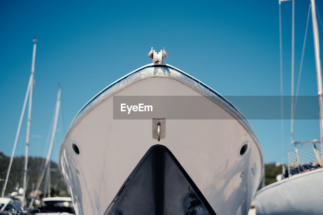 Closeup of moder ship front against blue sky
