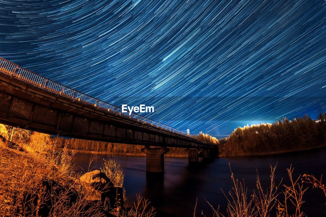 water, night, long exposure, bridge, built structure, architecture, star - space, space, bridge - man made structure, sky, astronomy, scenics - nature, nature, connection, star trail, motion, river, no people, blurred motion, outdoors