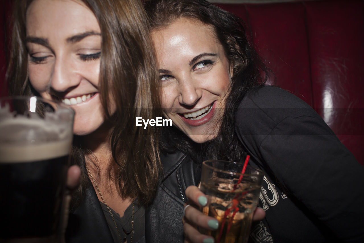 Two young women having drinks