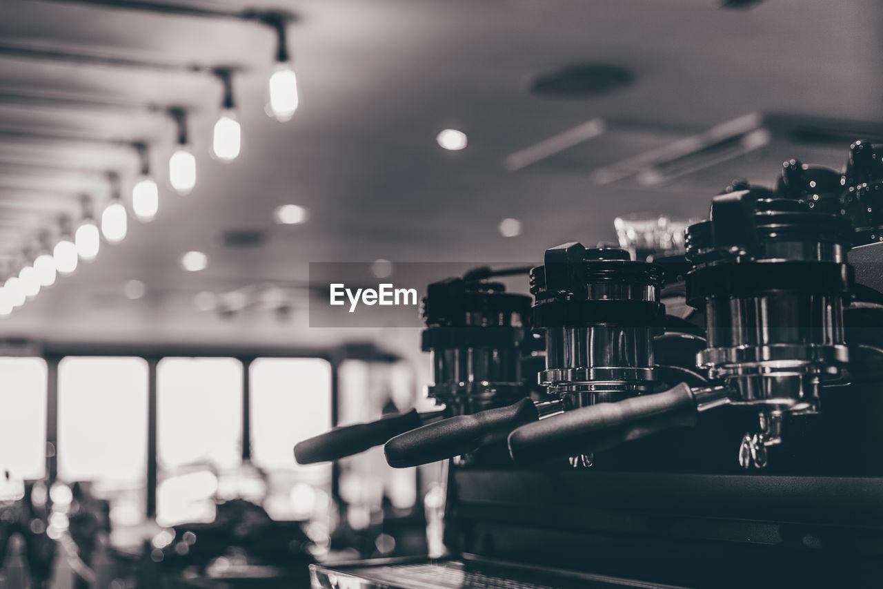 Close-Up Of Espresso Maker In Coffee Shop