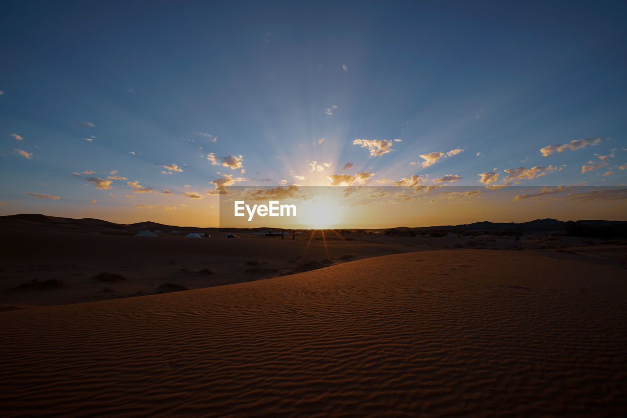Scenic View Of Desert Against Sky During Sunset