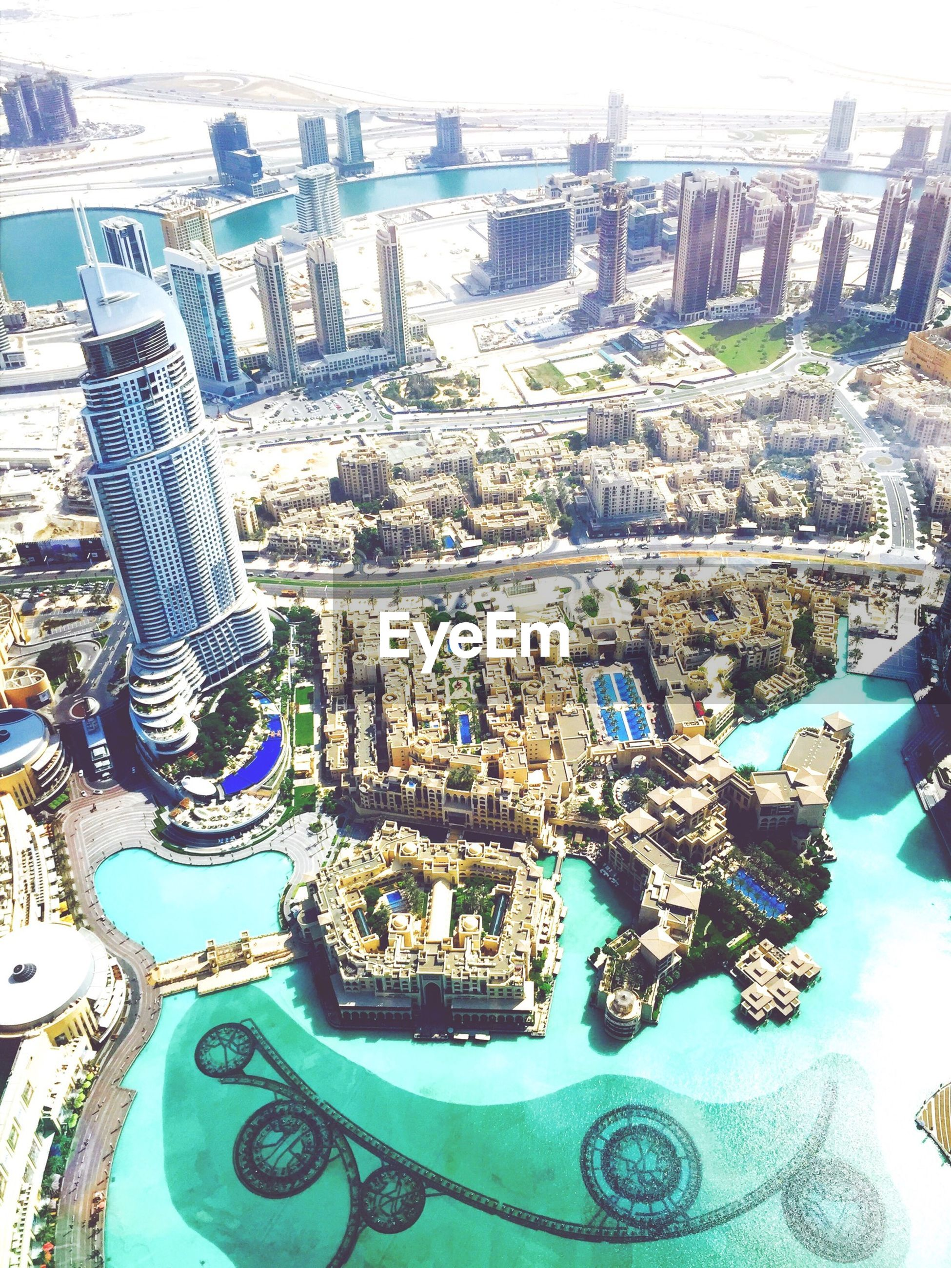 high angle view, cityscape, built structure, city, aerial view, day, architecture, large group of objects, building exterior, abundance, arrangement, no people, water, modern, outdoors, crowded, nature, table, chair, travel destinations