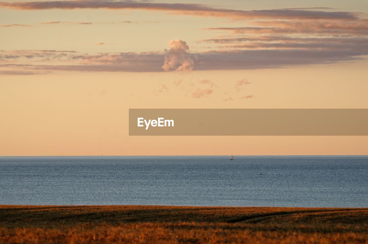 sea, sky, water, horizon, horizon over water, beauty in nature, scenics - nature, land, sunset, tranquility, tranquil scene, nature, beach, idyllic, real people, outdoors, cloud - sky, one person