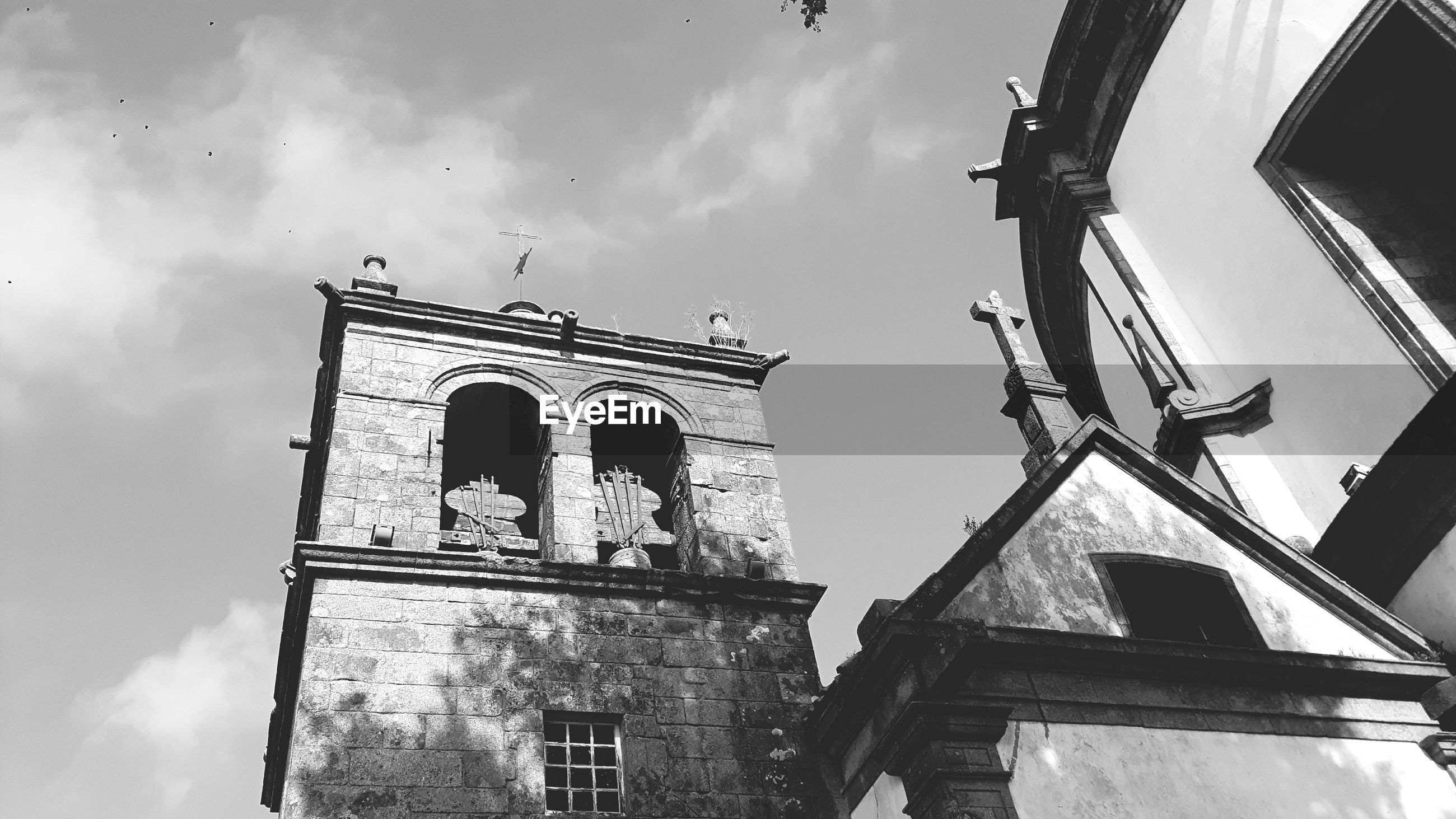 architecture, low angle view, built structure, building exterior, window, cloud - sky, sky, spirituality, religion, place of worship, outdoors, day, no people, history, bell tower