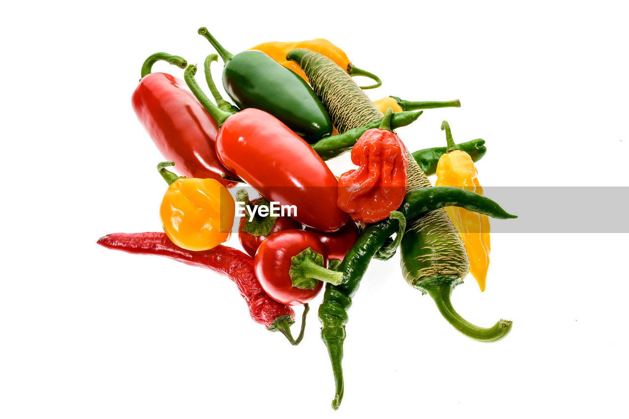 white background, food and drink, studio shot, vegetable, freshness, pepper, bell pepper, food, pepper - vegetable, spice, cut out, red bell pepper, green chili pepper, healthy eating, stem, no people, raw food, green color, ingredient, close-up, yellow, day