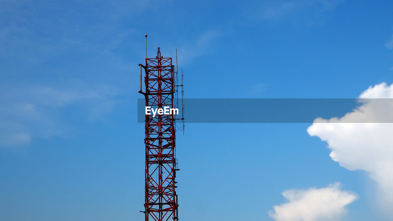 sky, cloud - sky, built structure, low angle view, architecture, day, metal, communication, no people, tall - high, nature, tower, blue, outdoors, technology, construction industry, development, industry, connection, global communications, construction equipment