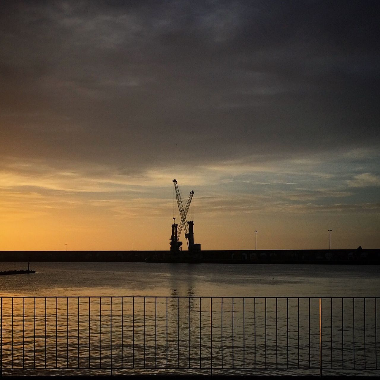 sunset, industry, sky, silhouette, no people, cloud - sky, dusk, water, waterfront, crane, fuel and power generation, outdoors, nature, sea, scenics, day, offshore platform, drilling rig, shipyard, oil pump