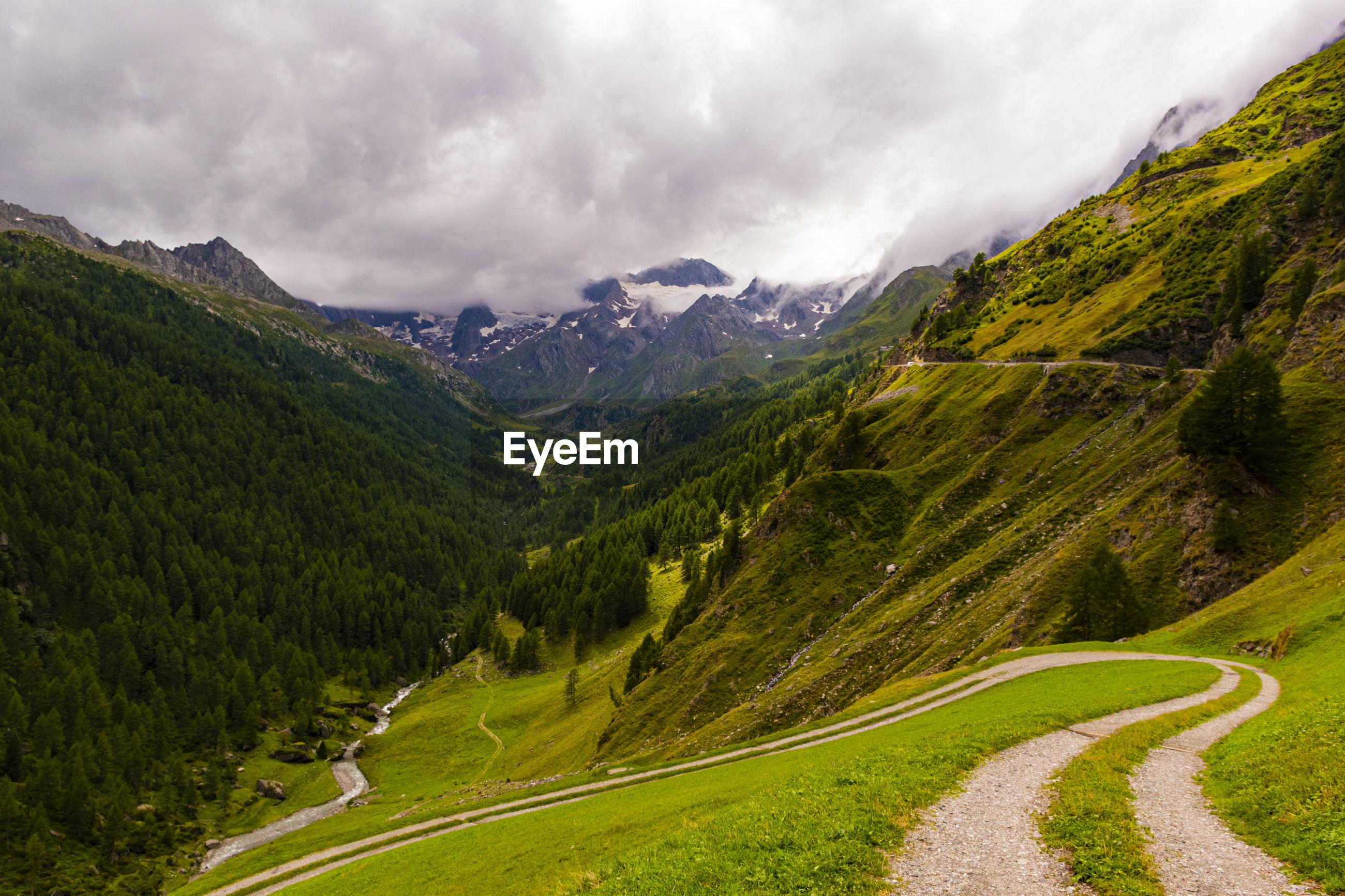 Scenic view of road amidst mountains against sky