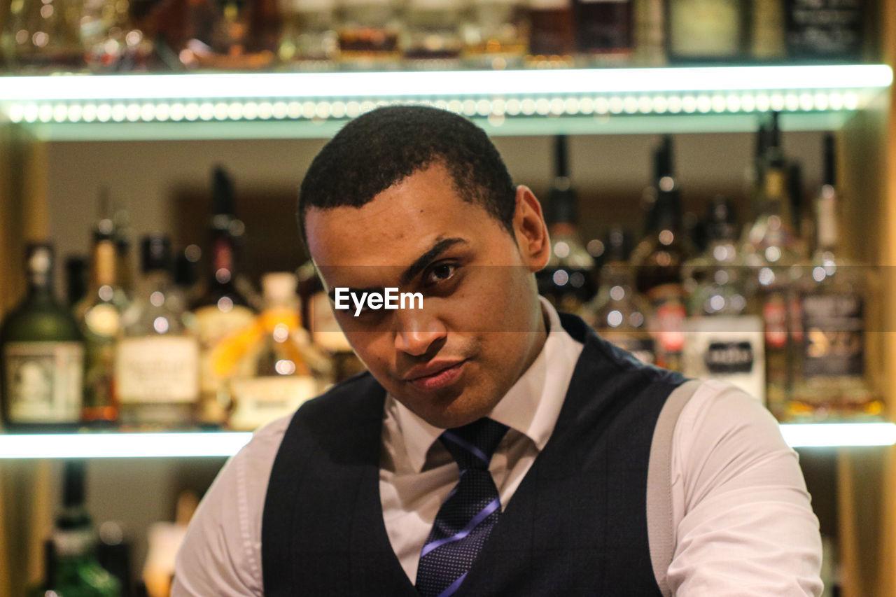 Portrait of bartender in bar