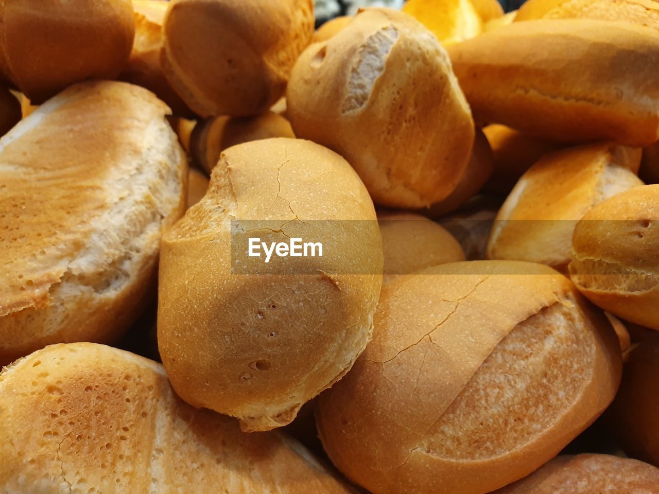 food, food and drink, freshness, full frame, still life, backgrounds, large group of objects, wellbeing, healthy eating, close-up, bread, no people, brown, indoors, abundance, focus on foreground, baked, ready-to-eat, high angle view, selective focus, snack