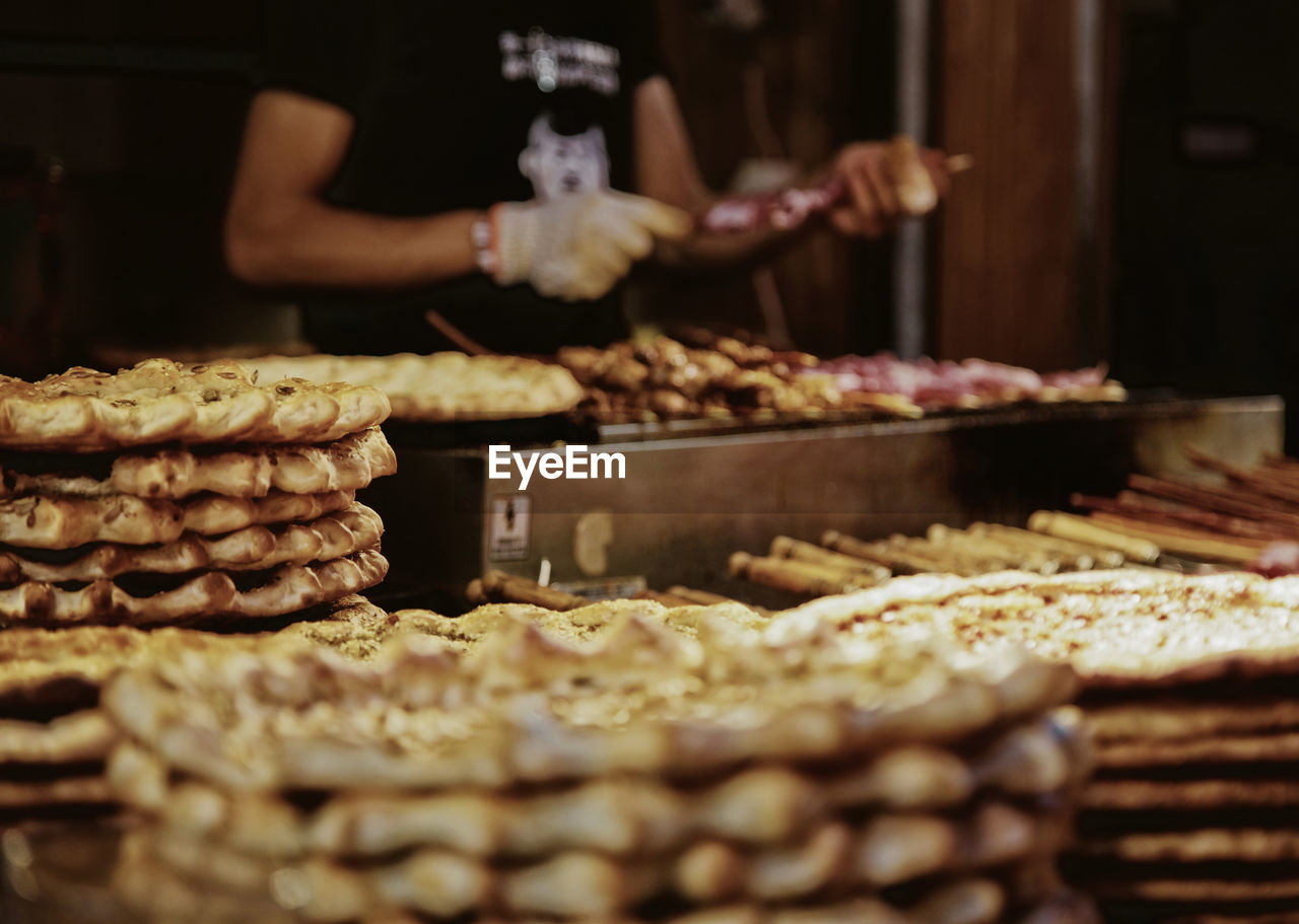 Bakery Close-up Day Food Food And Drink For Sale Freshness Human Body Part Human Hand Indoors  Men Midsection Occupation One Person People Ready-to-eat Real People Selective Focus Sweet Food