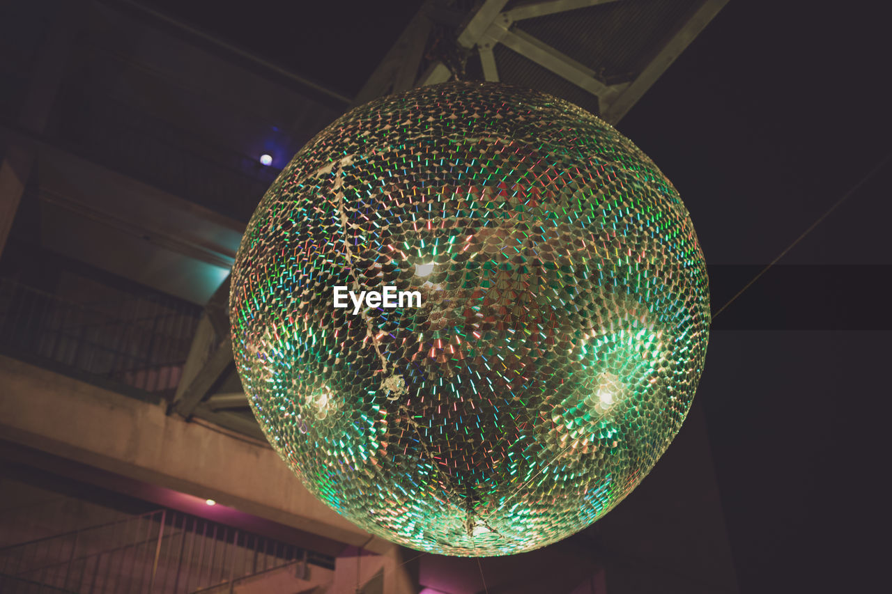 illuminated, lighting equipment, indoors, ceiling, decoration, low angle view, no people, hanging, pattern, light, close-up, electricity, pendant light, night, glowing, light - natural phenomenon, sphere, electric light, design, focus on foreground, electric lamp, light fixture, nightlife