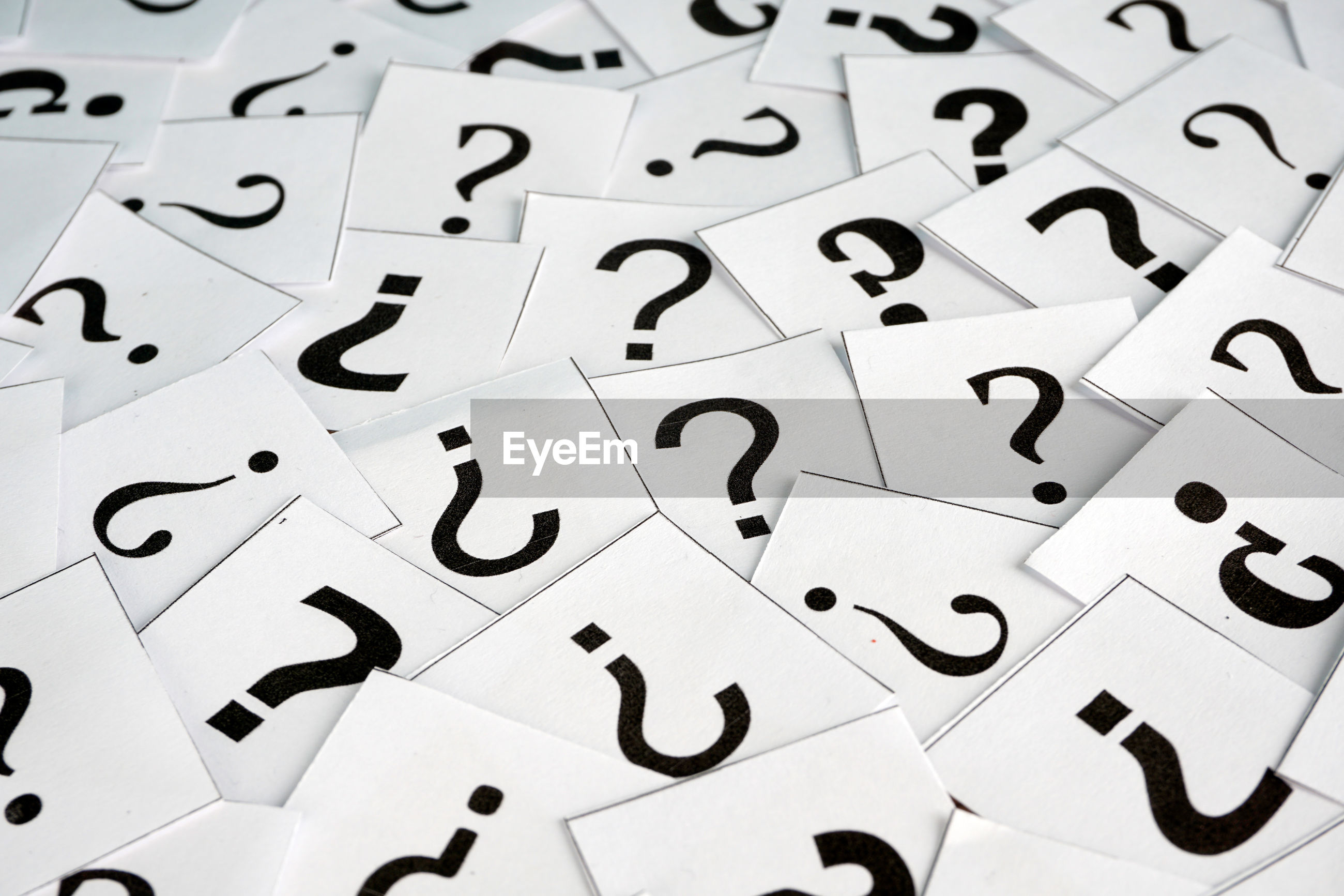 Full frame short of question mark sign on papers