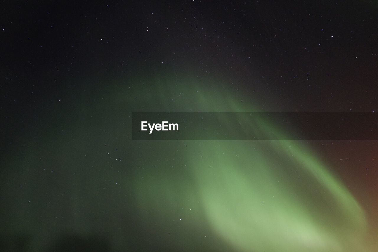 Scenic view of aurora against star field