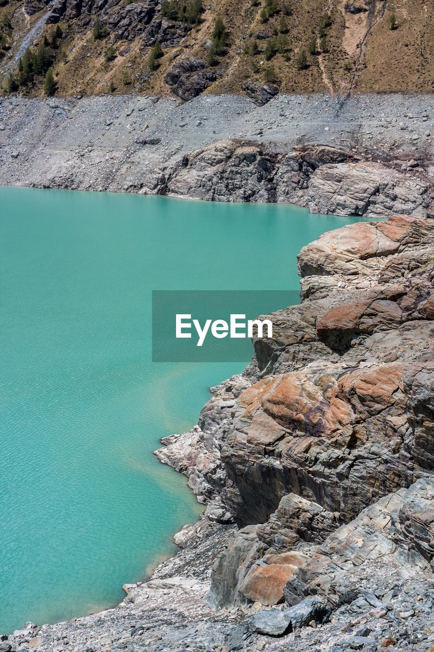 water, rock - object, nature, beauty in nature, no people, day, physical geography, outdoors, tranquility, scenics, tranquil scene, lake, mountain, sky