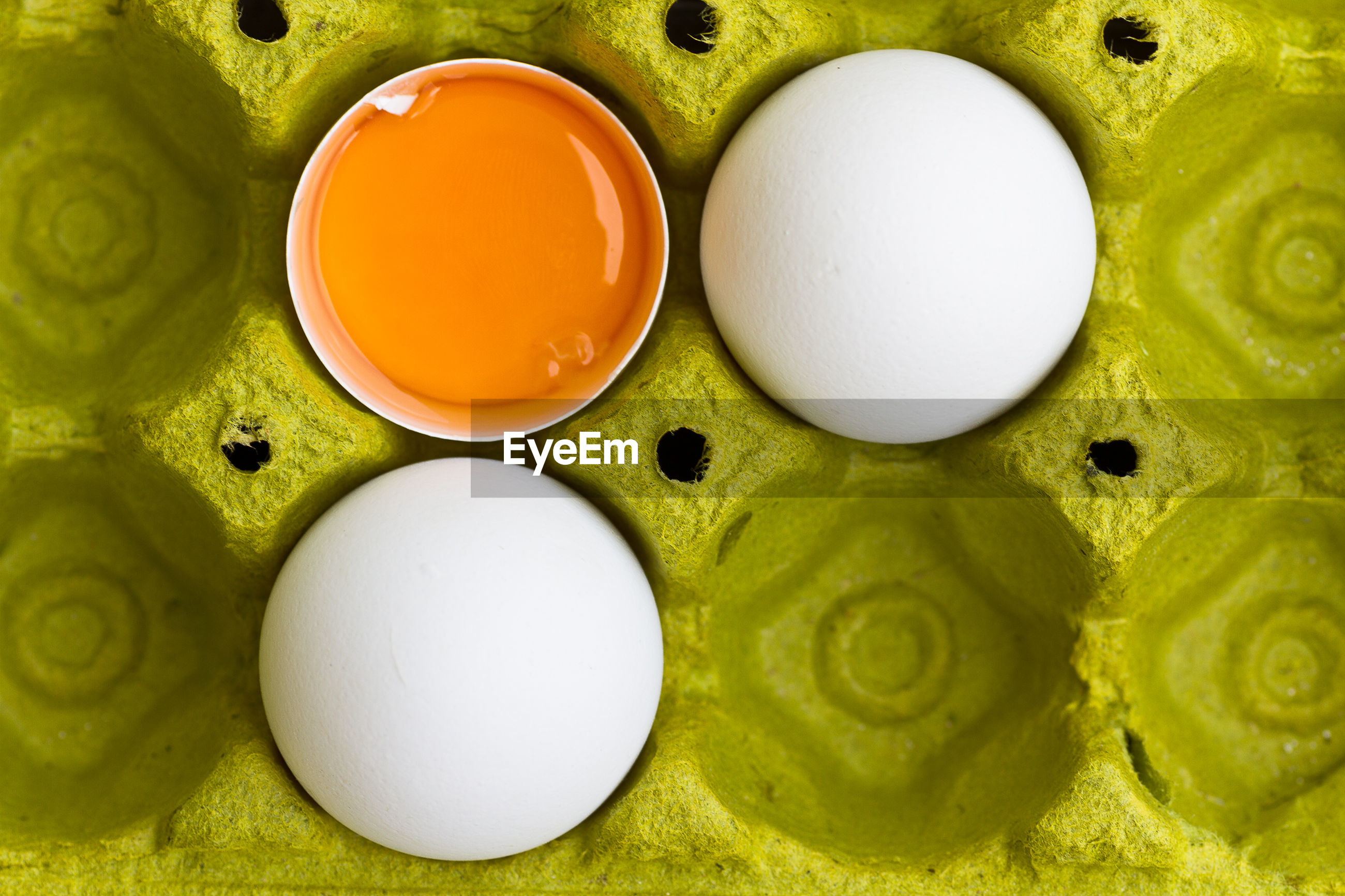 Directly above shot of eggs on carton