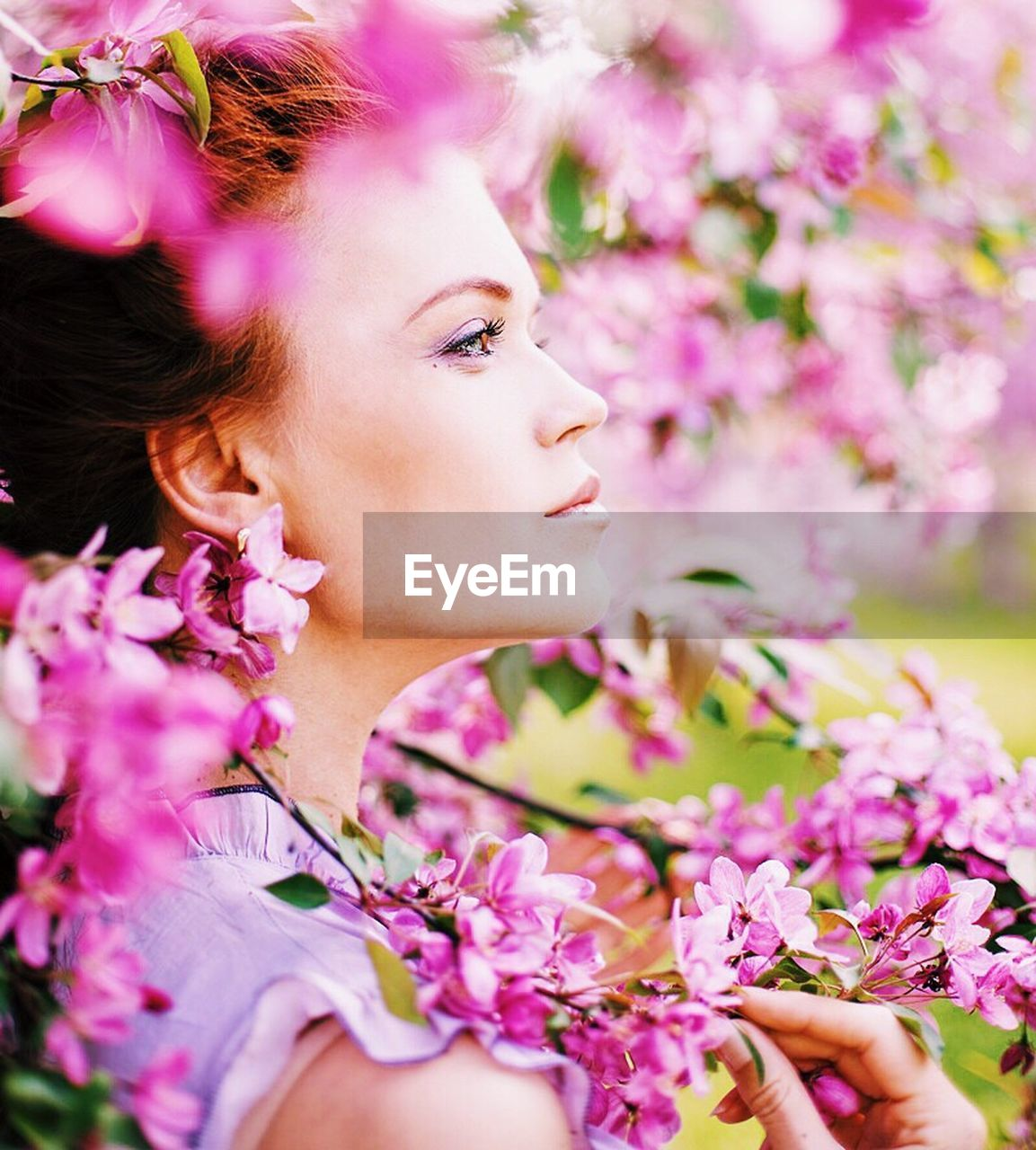 flower, blossom, fragility, pink color, beautiful woman, beauty in nature, young adult, one person, nature, young women, beauty, springtime, freshness, headshot, close-up, real people, outdoors, branch, day, tree, flower head, one young woman only, people