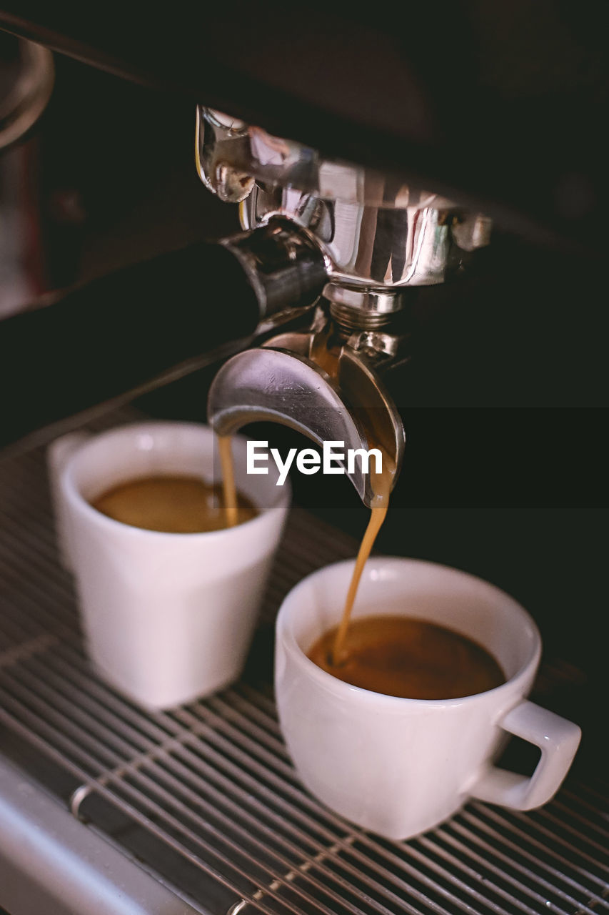 coffee - drink, coffee cup, drink, refreshment, cup, food and drink, espresso maker, freshness, close-up, pouring, indoors, motion, no people, heat - temperature, cafe, day