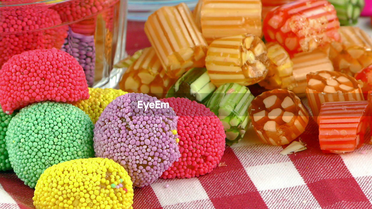 multi colored, variation, choice, no people, food and drink, food, large group of objects, indoors, container, close-up, still life, freshness, art and craft, textile, studio shot, candy, group of objects, material, corn, jar