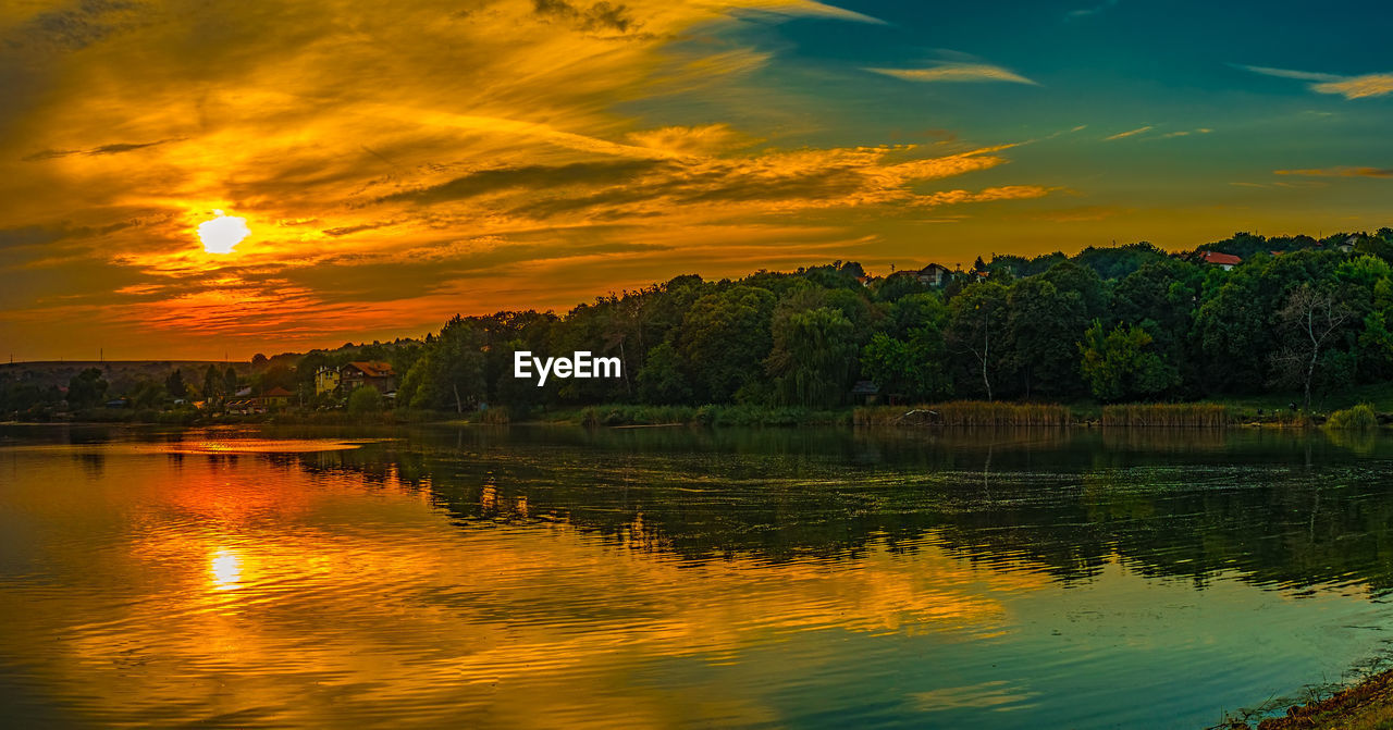 sky, water, reflection, sunset, beauty in nature, scenics - nature, cloud - sky, lake, waterfront, tranquility, tranquil scene, orange color, nature, tree, no people, idyllic, plant, non-urban scene, outdoors