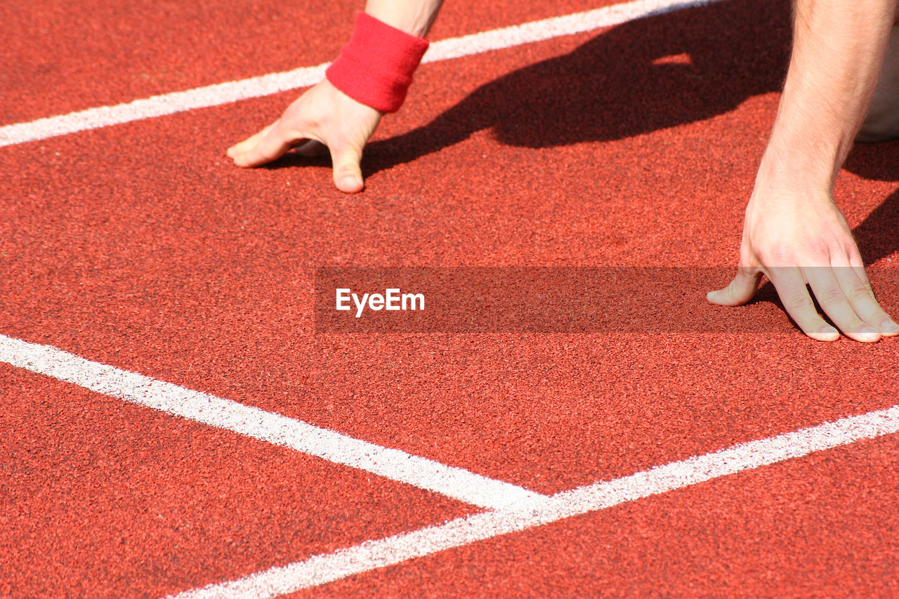 Cropped Image Of Person At Track Field