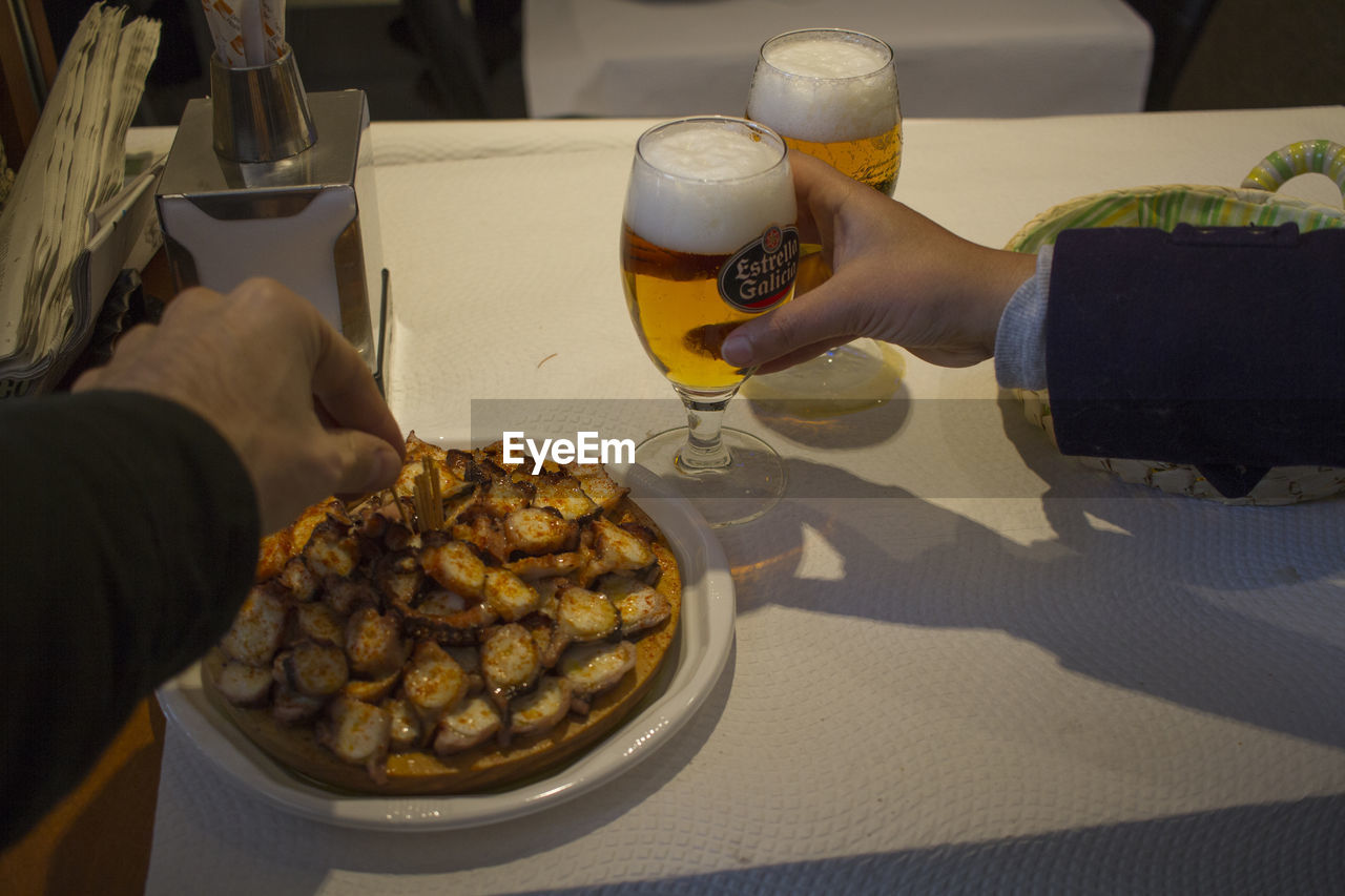 food and drink, human hand, real people, human body part, food, drink, table, freshness, holding, refreshment, beer glass, beer - alcohol, alcohol, men, drinking glass, beer, lifestyles, leisure activity, plate, ready-to-eat, indoors, women, close-up, day, people