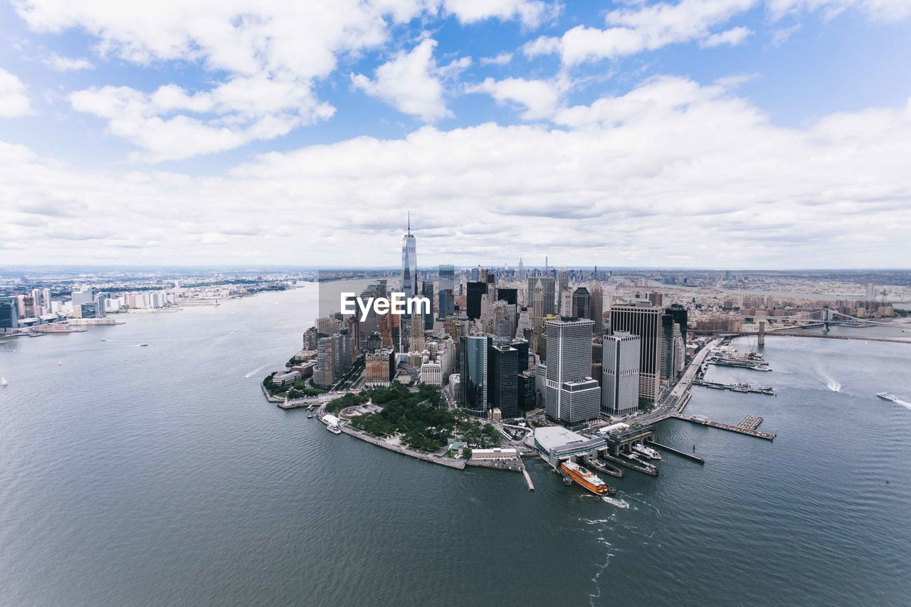 building exterior, architecture, built structure, water, city, sky, cityscape, cloud - sky, sea, nature, waterfront, building, transportation, day, office building exterior, skyscraper, nautical vessel, no people, travel destinations, outdoors, financial district