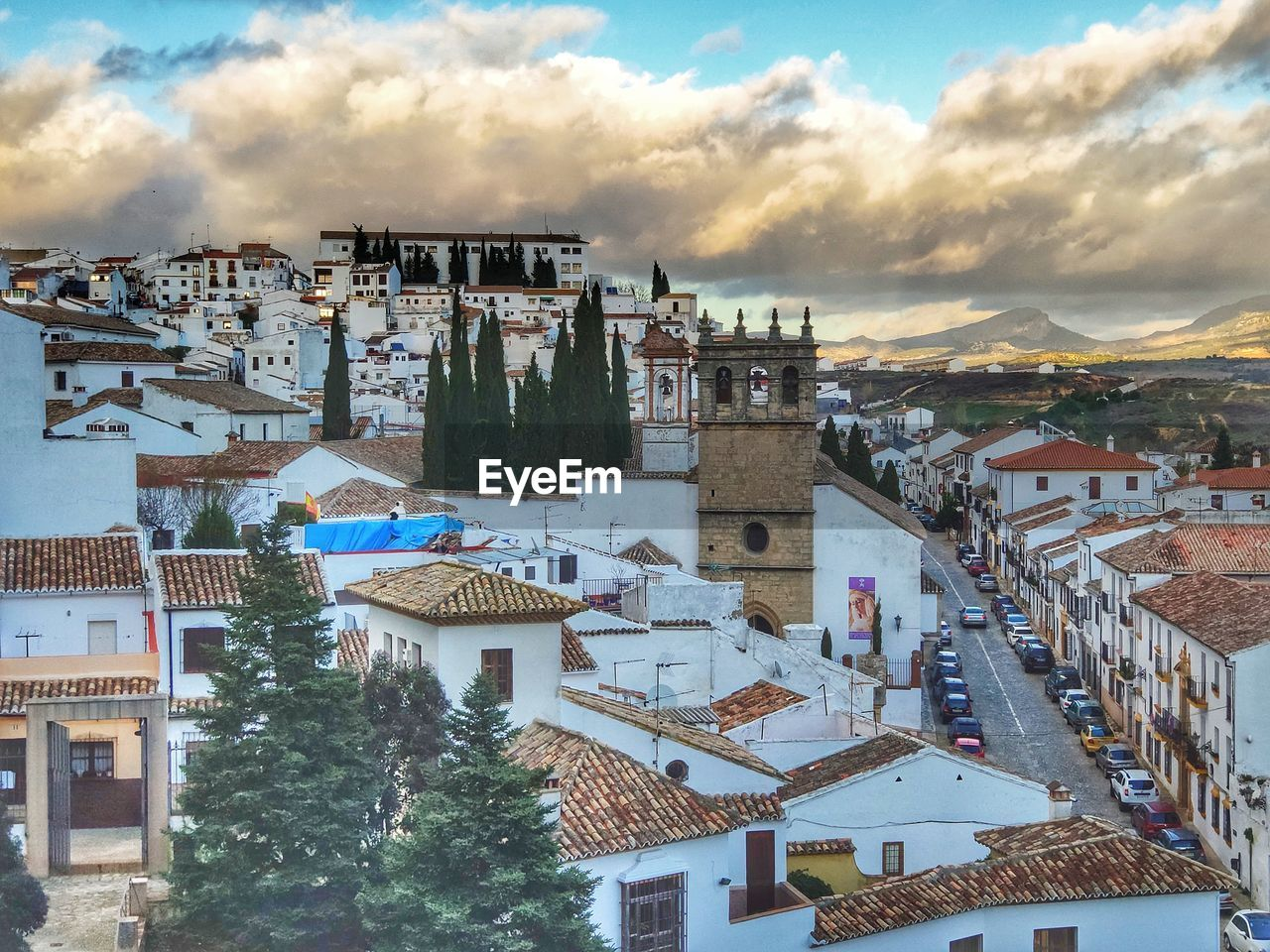 architecture, building exterior, built structure, building, cloud - sky, sky, residential district, city, town, nature, roof, high angle view, house, townscape, crowd, crowded, community, mountain, day, outdoors, cityscape, settlement