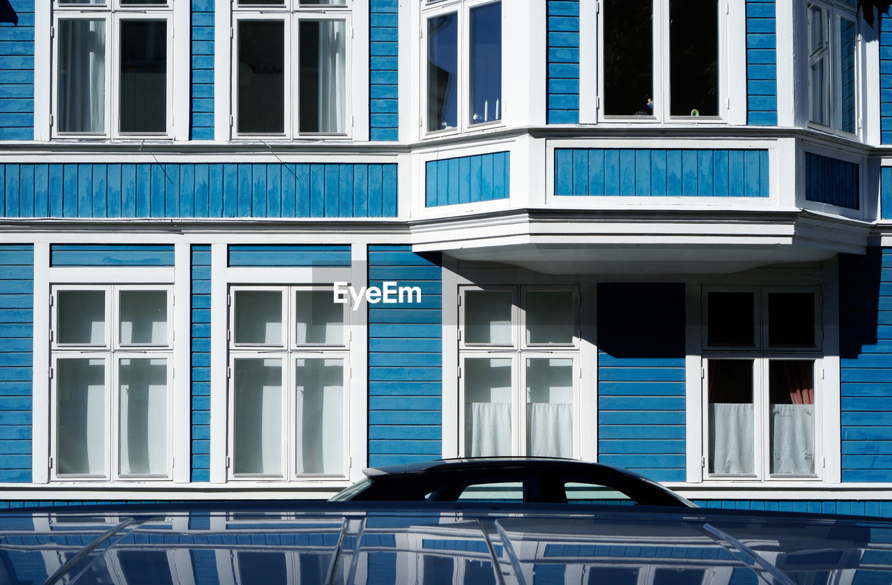 built structure, building exterior, window, architecture, blue, no people, building, glass - material, day, city, modern, full frame, backgrounds, reflection, outdoors, white color, pattern, in a row, transparent, apartment, turquoise colored