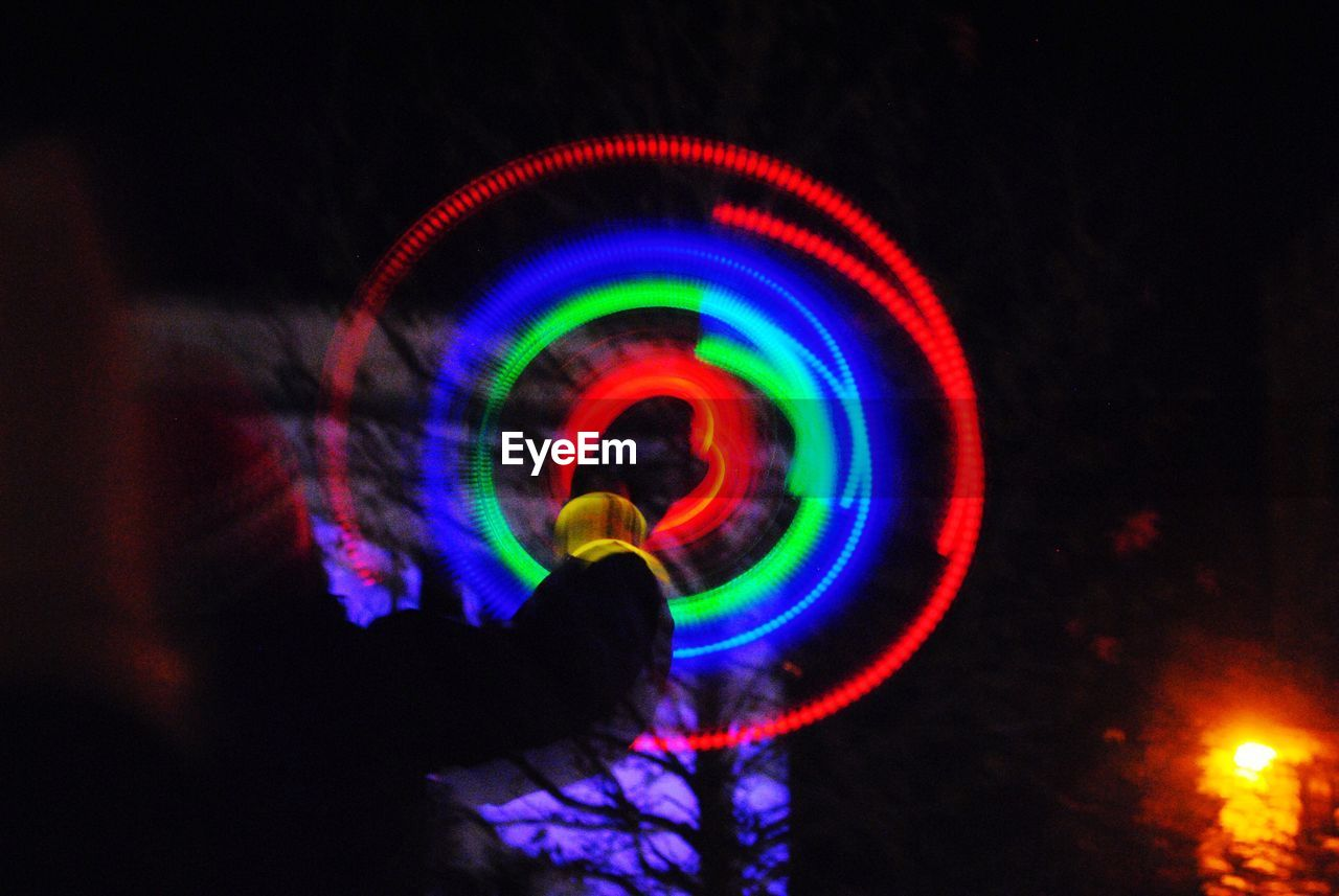 multi colored, illuminated, night, low angle view, rainbow, outdoors, motion, real people, nature