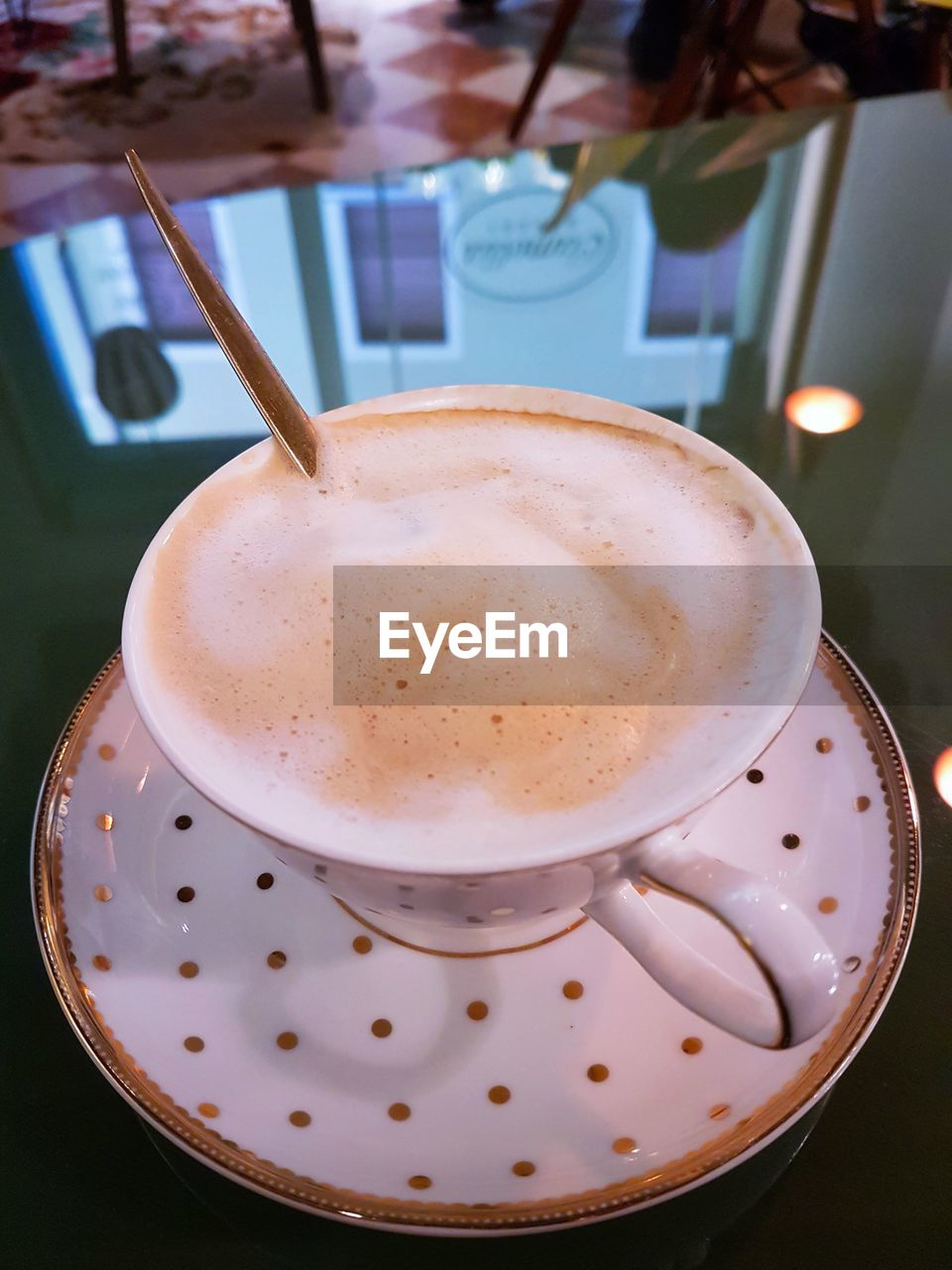 drink, refreshment, food and drink, frothy drink, coffee cup, coffee - drink, table, indoors, close-up, freshness, saucer, high angle view, focus on foreground, no people, cappuccino, froth art, food, day