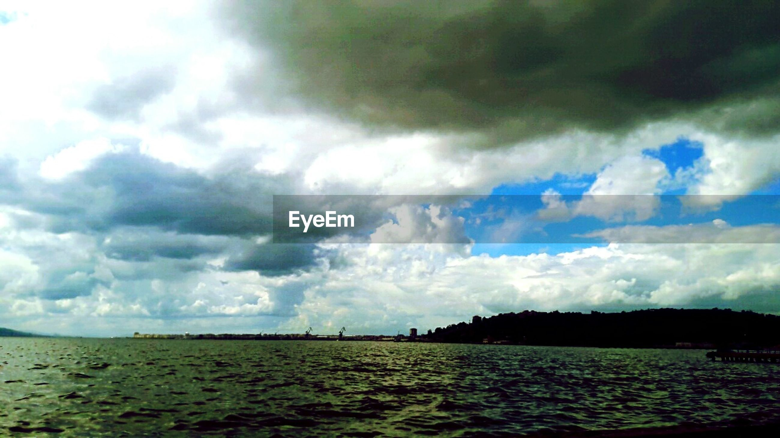 sky, cloud - sky, cloudy, tranquil scene, tranquility, scenics, beauty in nature, landscape, nature, cloud, field, grass, weather, overcast, water, sea, idyllic, storm cloud, day, remote