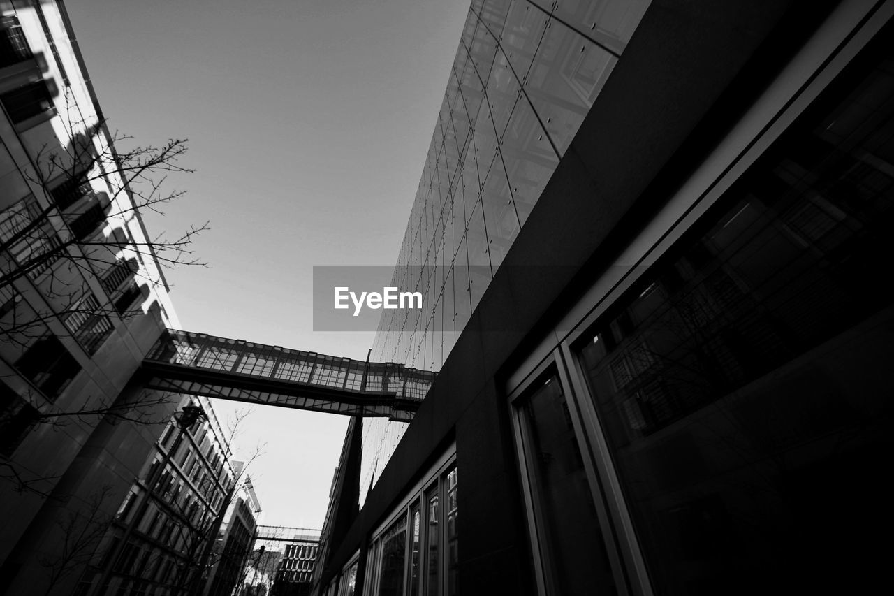 architecture, built structure, building exterior, low angle view, no people, city, outdoors, day, clear sky, skyscraper, modern, sky