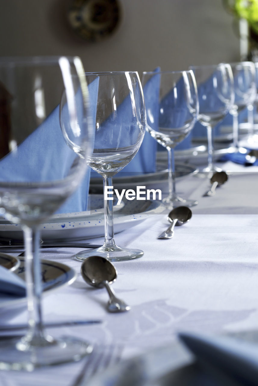 Row of wineglasses on table at restaurant