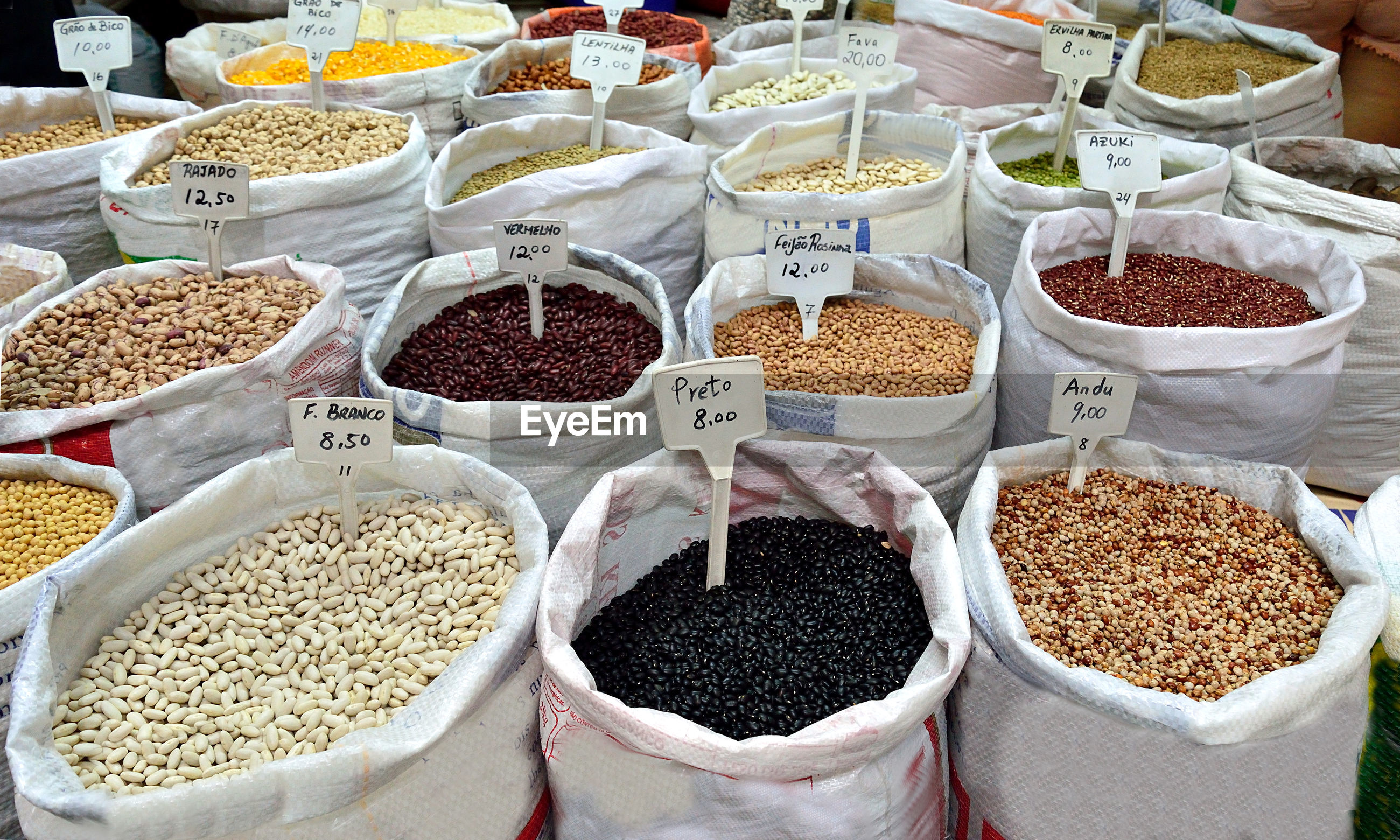 Full frame shot of various food in sacks for sale at market