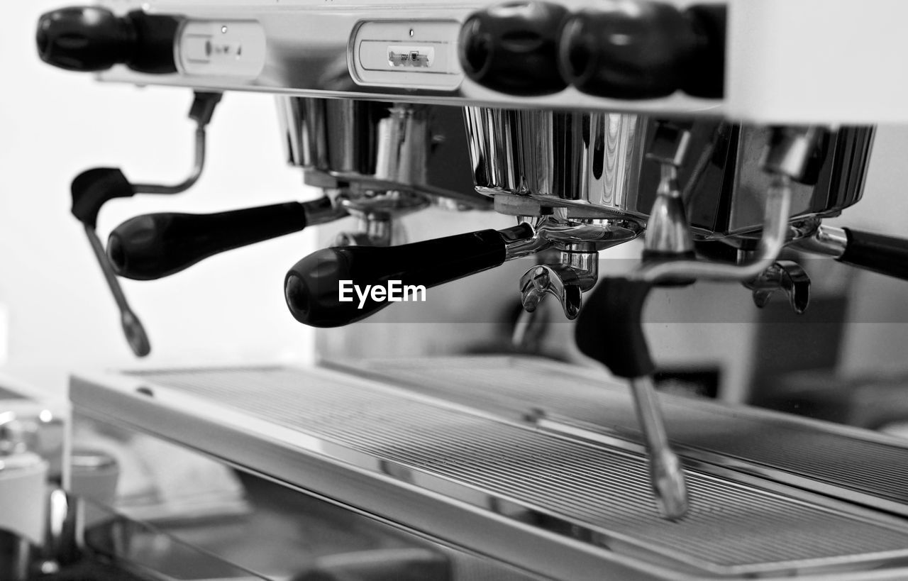 indoors, machinery, focus on foreground, coffee maker, close-up, no people, espresso maker, metal, coffee, food and drink, technology, appliance, selective focus, machine part, handle, drink, equipment, coffee - drink, refreshment, cafe