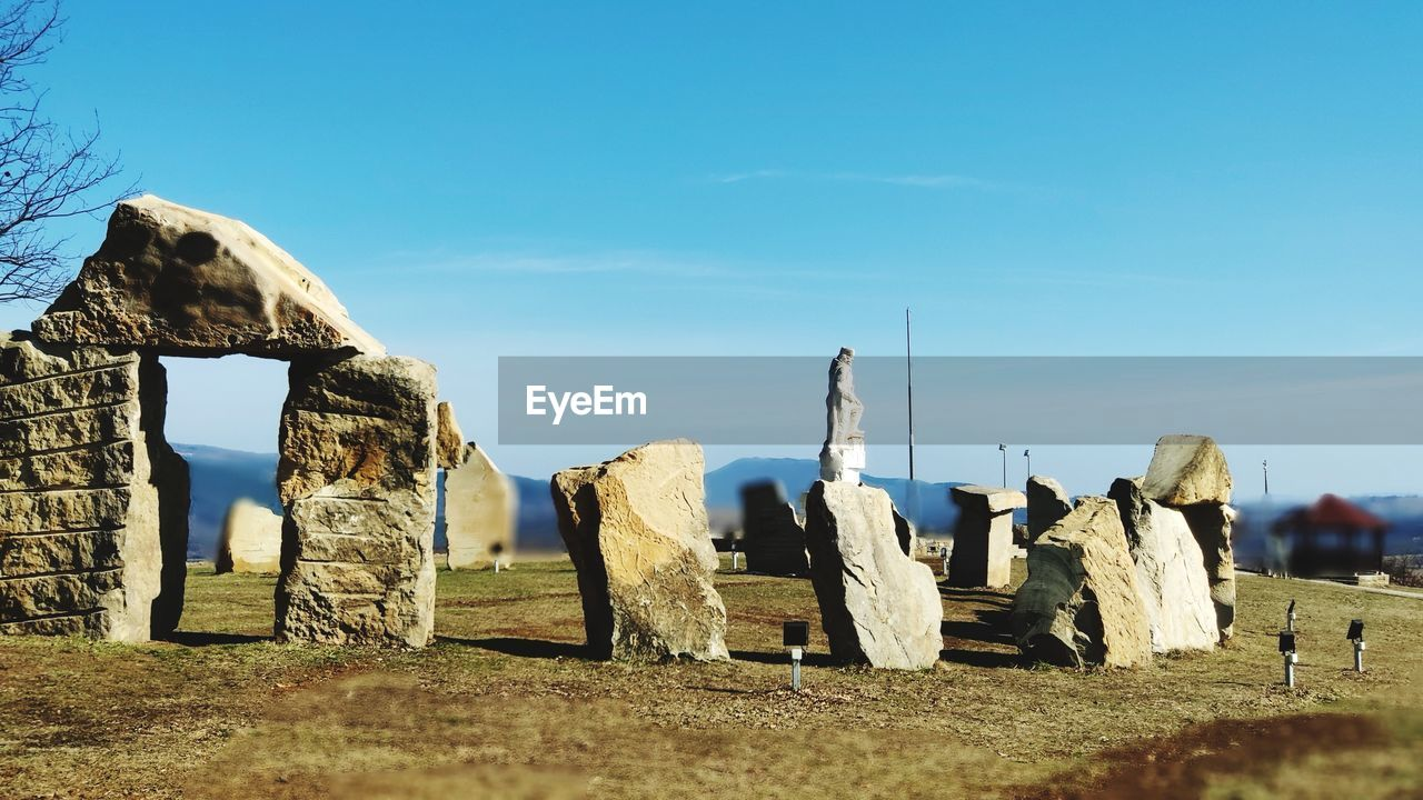 sky, the past, history, nature, solid, architecture, no people, land, day, travel, memorial, travel destinations, rock, ancient, tourism, rock - object, blue, monument, sunlight, field, ancient civilization, outdoors, stone material, archaeology