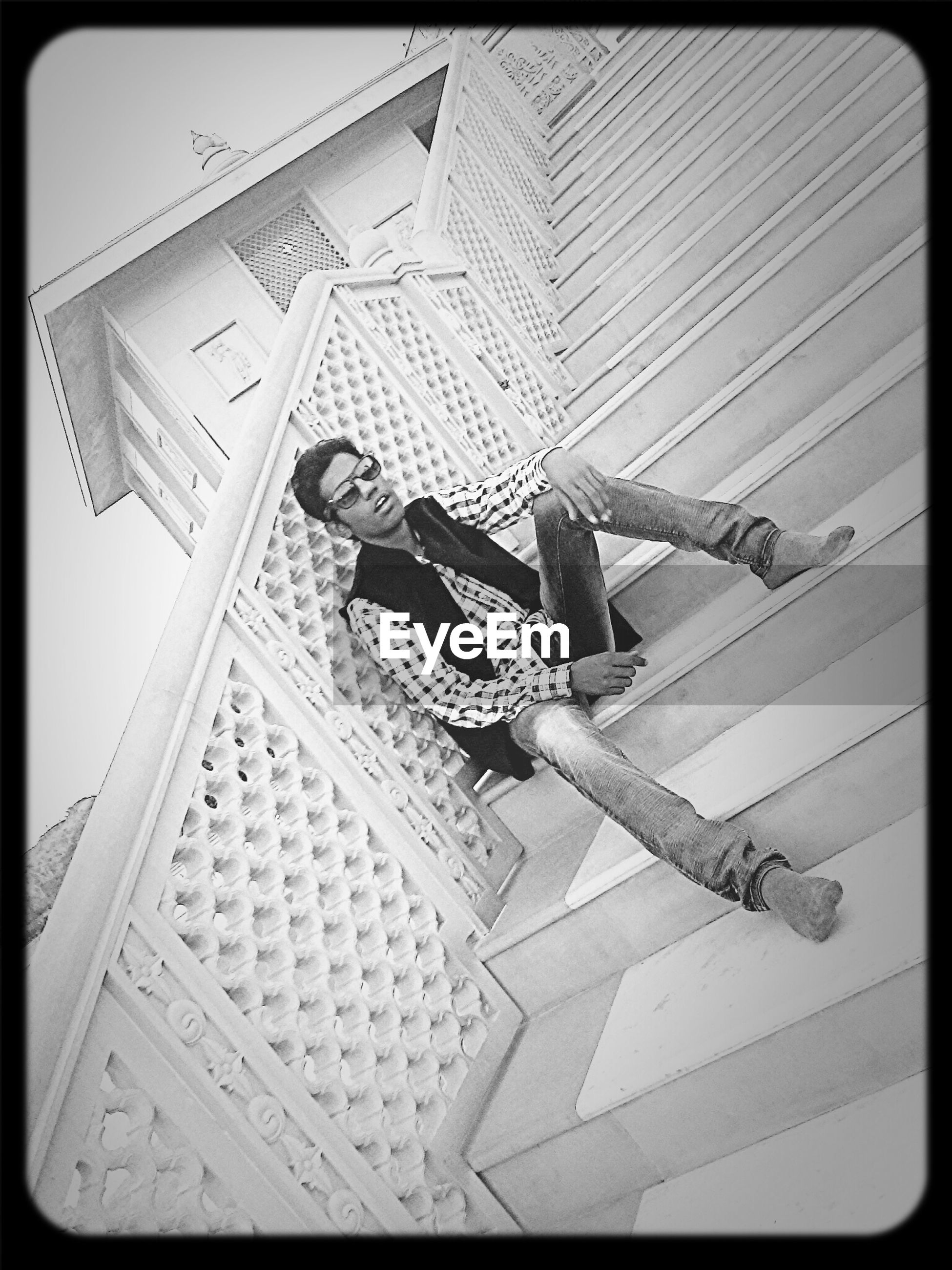 transfer print, auto post production filter, built structure, architecture, building exterior, low angle view, art and craft, art, creativity, wall - building feature, day, wood - material, no people, outdoors, tilt, high angle view, hanging, text, paper