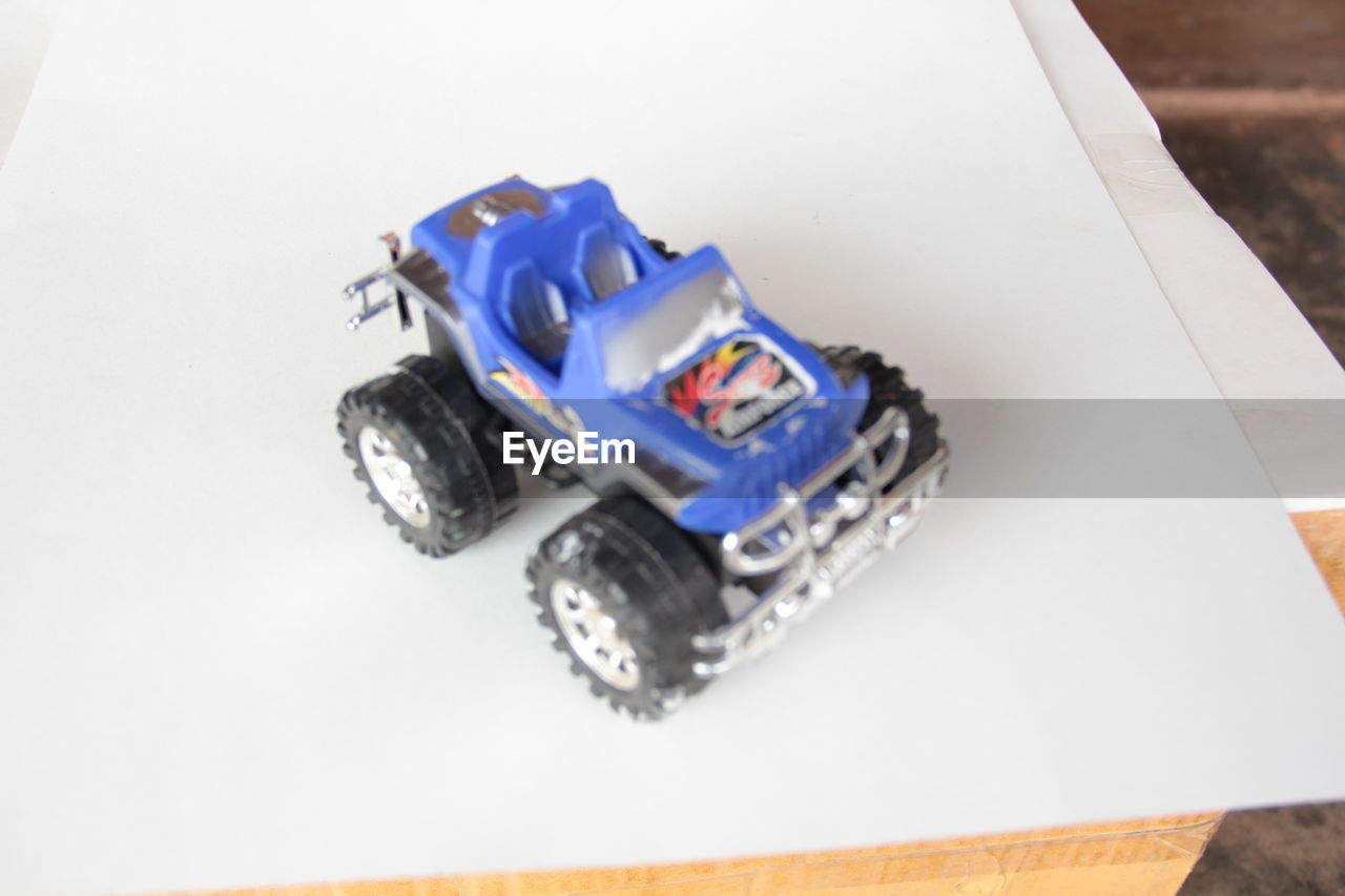 toy car, high angle view, no people, close-up, white background, studio shot, childhood, indoors, day