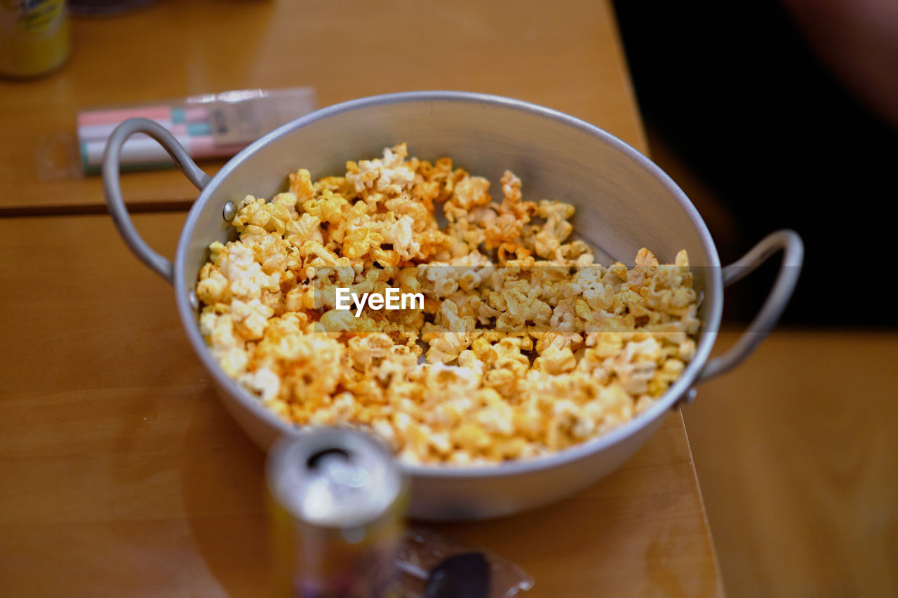 food, food and drink, table, bowl, indoors, healthy eating, wellbeing, freshness, still life, close-up, breakfast cereal, meal, kitchen utensil, high angle view, wood - material, breakfast, spoon, eating utensil, no people, focus on foreground, snack, temptation