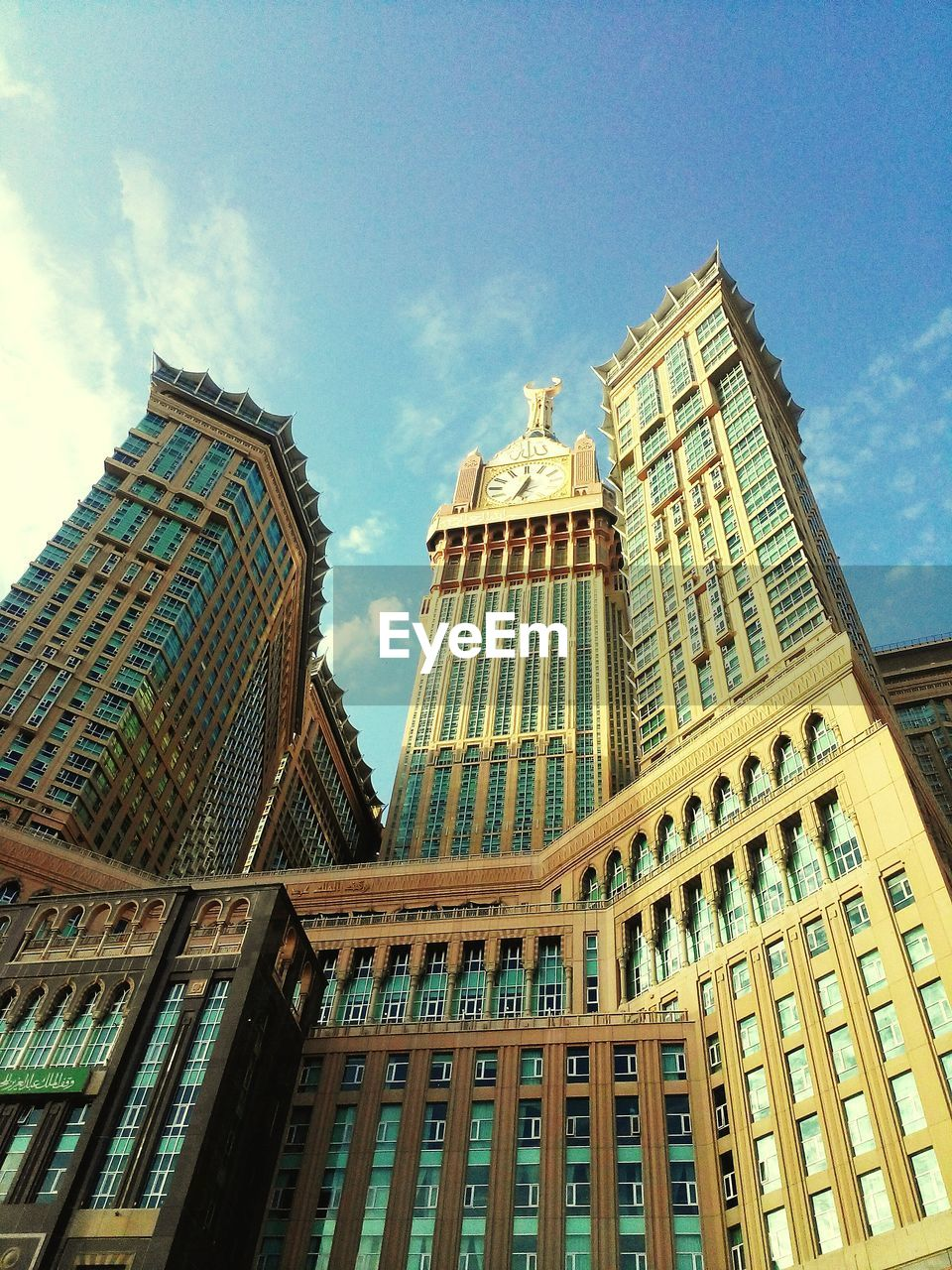 architecture, building exterior, low angle view, built structure, skyscraper, sky, day, outdoors, city, no people, modern