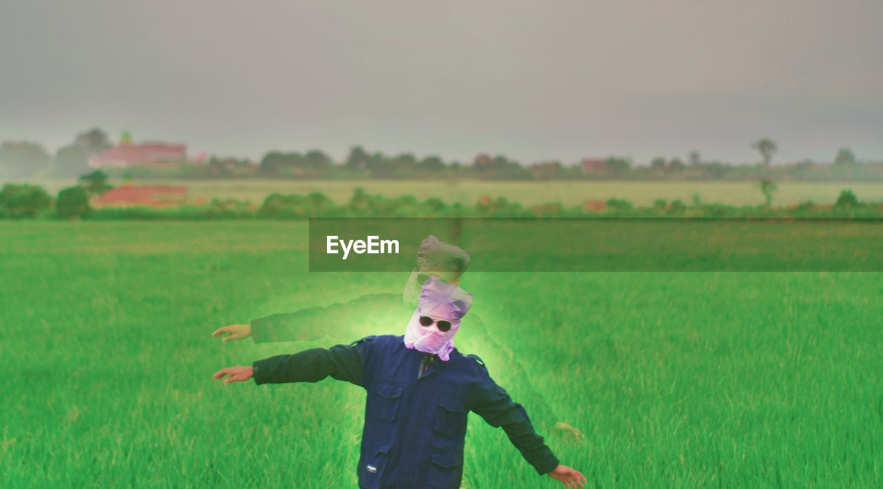 Multiple Image Of Man Wearing Plastic Bag With Sunglasses At Farm Against Sky