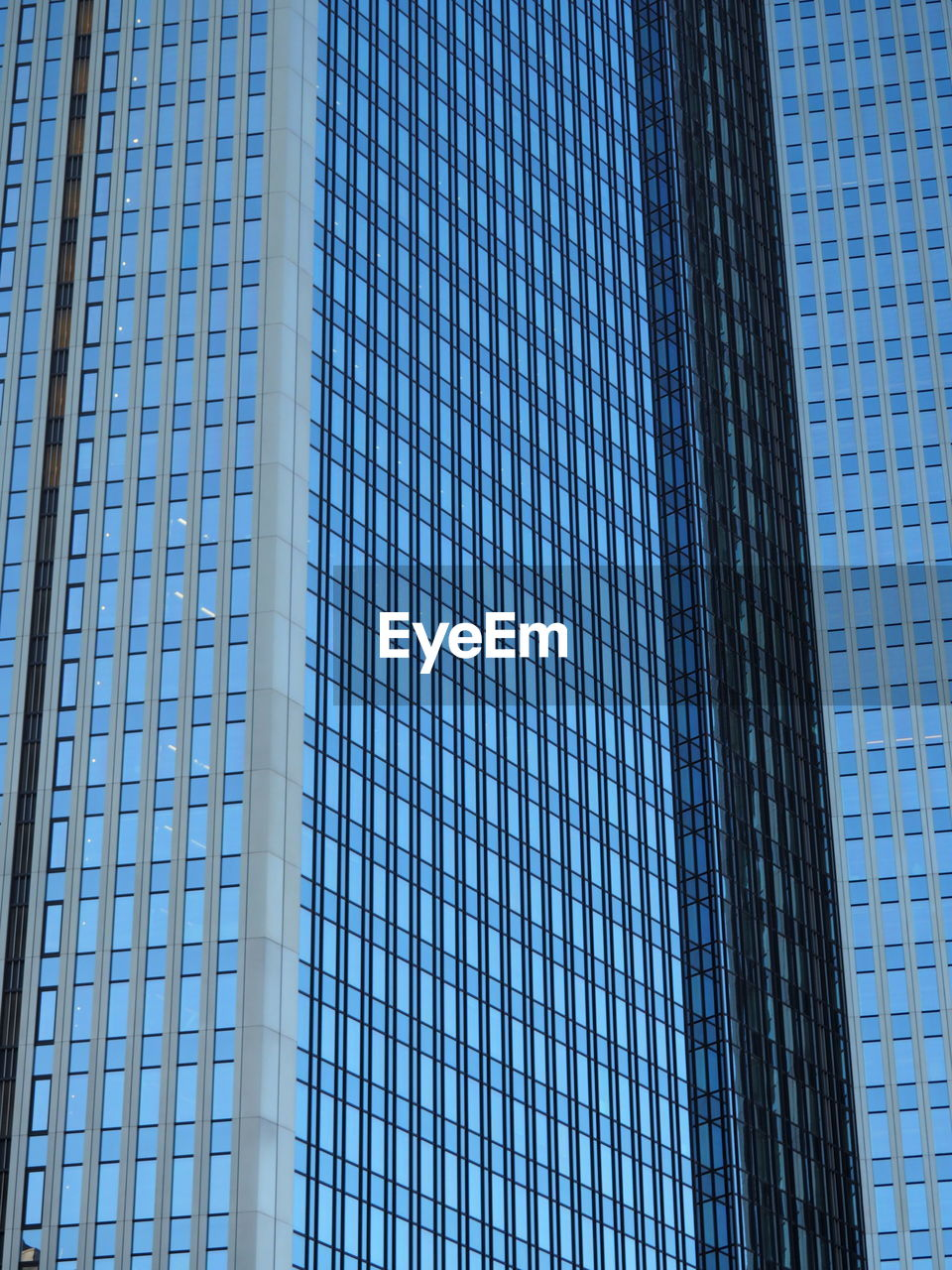 low angle view, architecture, skyscraper, built structure, modern, building exterior, blue, tower, day, full frame, backgrounds, tall, city, outdoors, window, no people, corporate business, sky